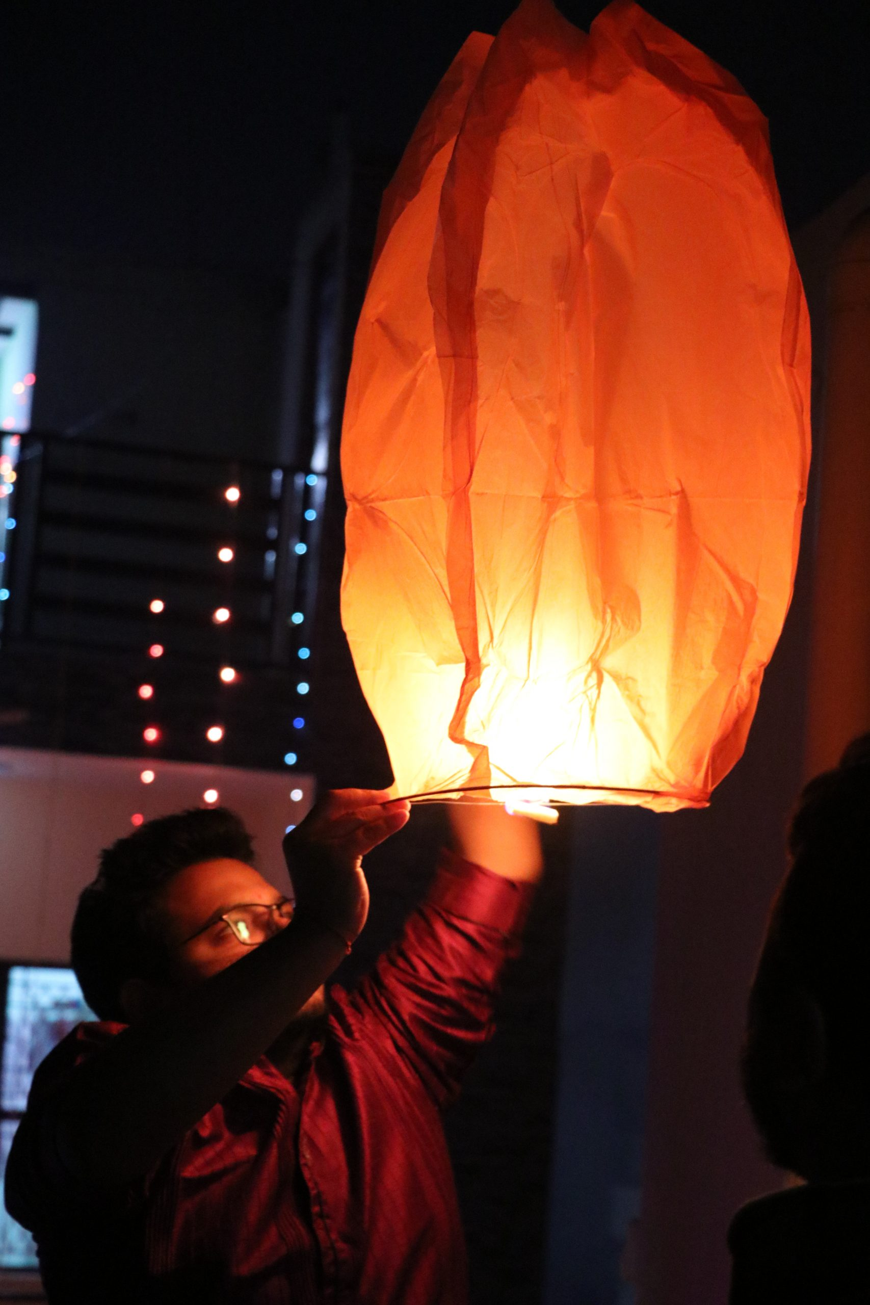 A boy with sky lantern