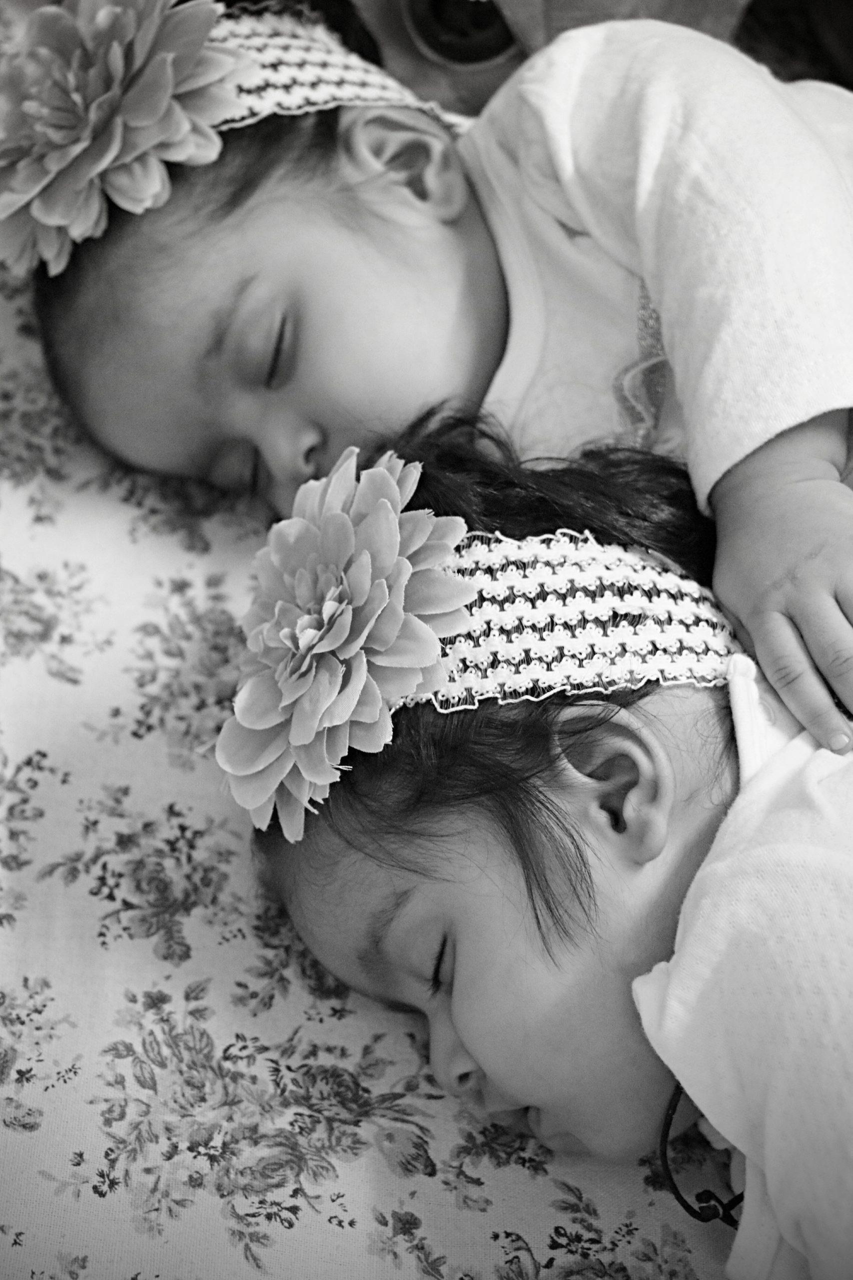 Little twin girl sleeping