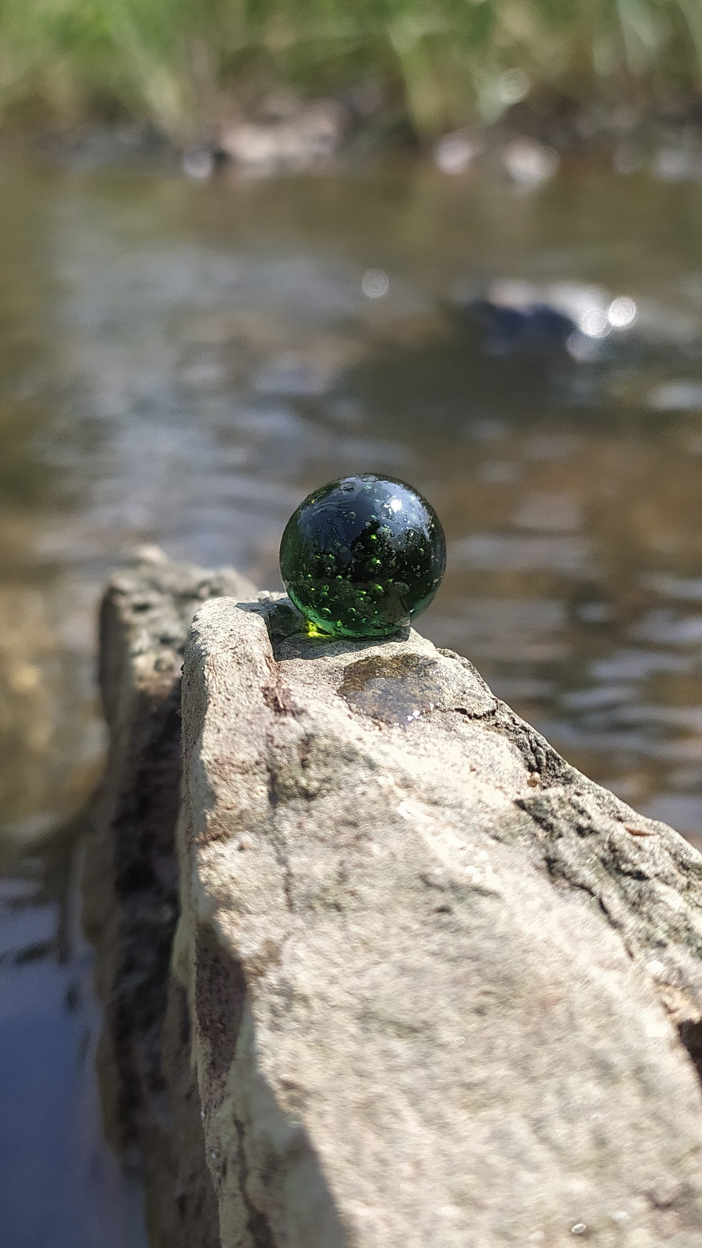 A marvel ball on a stone