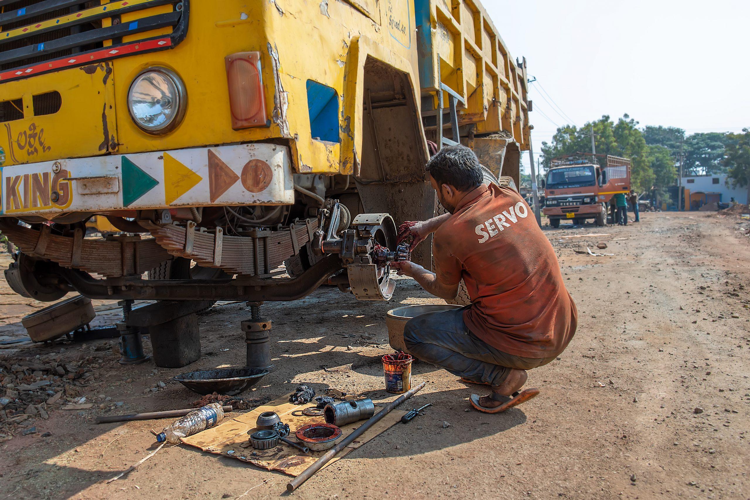 mechanic repairing truck tyre