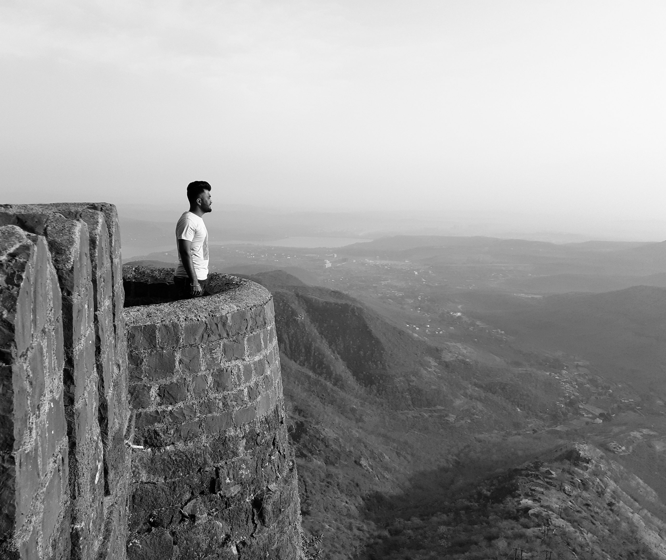 man looking from a fort