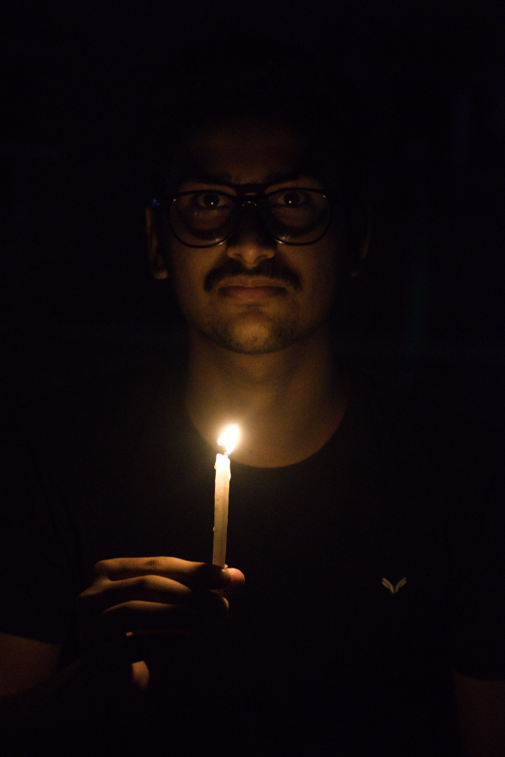 Man with candle