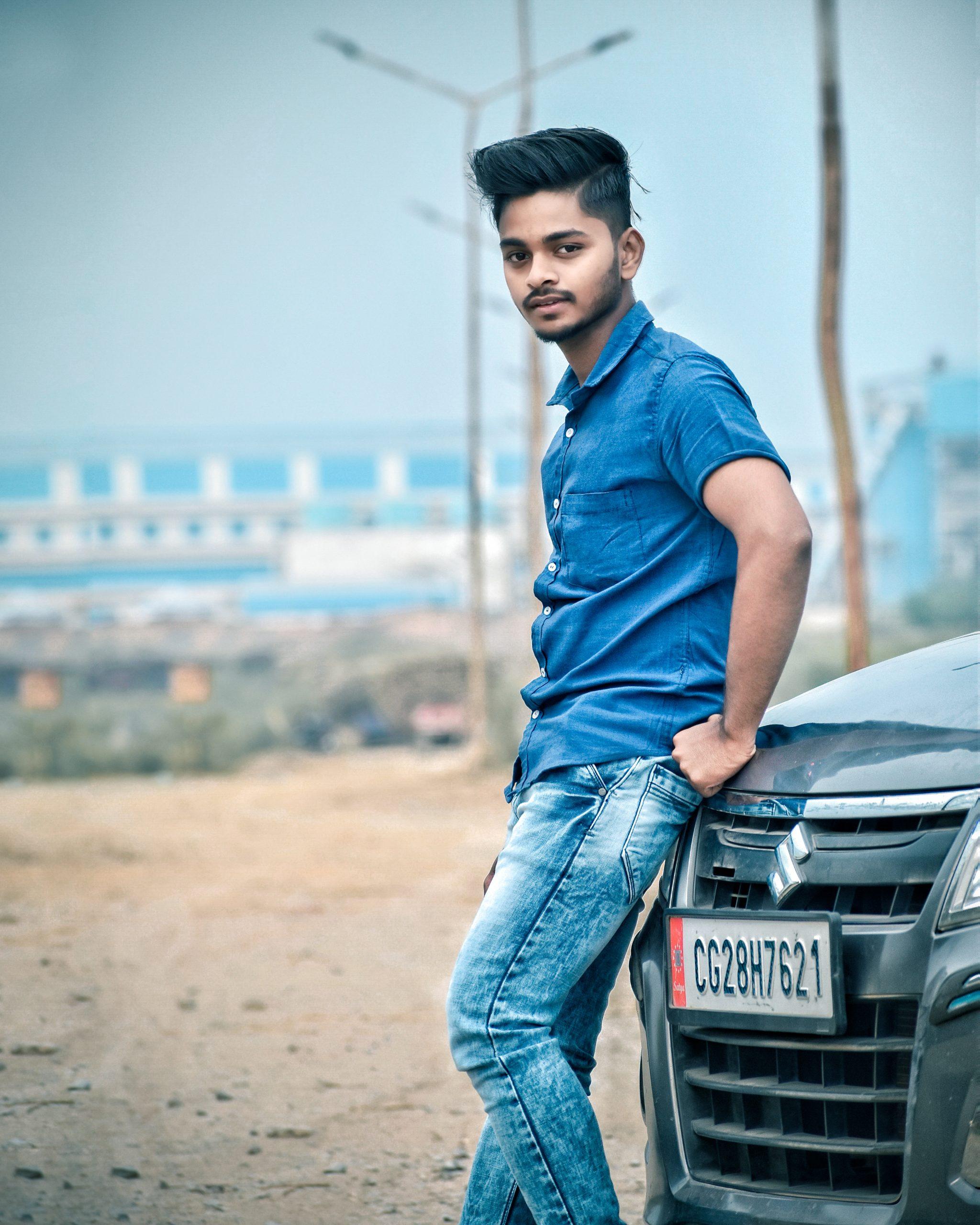 man posing infront of car