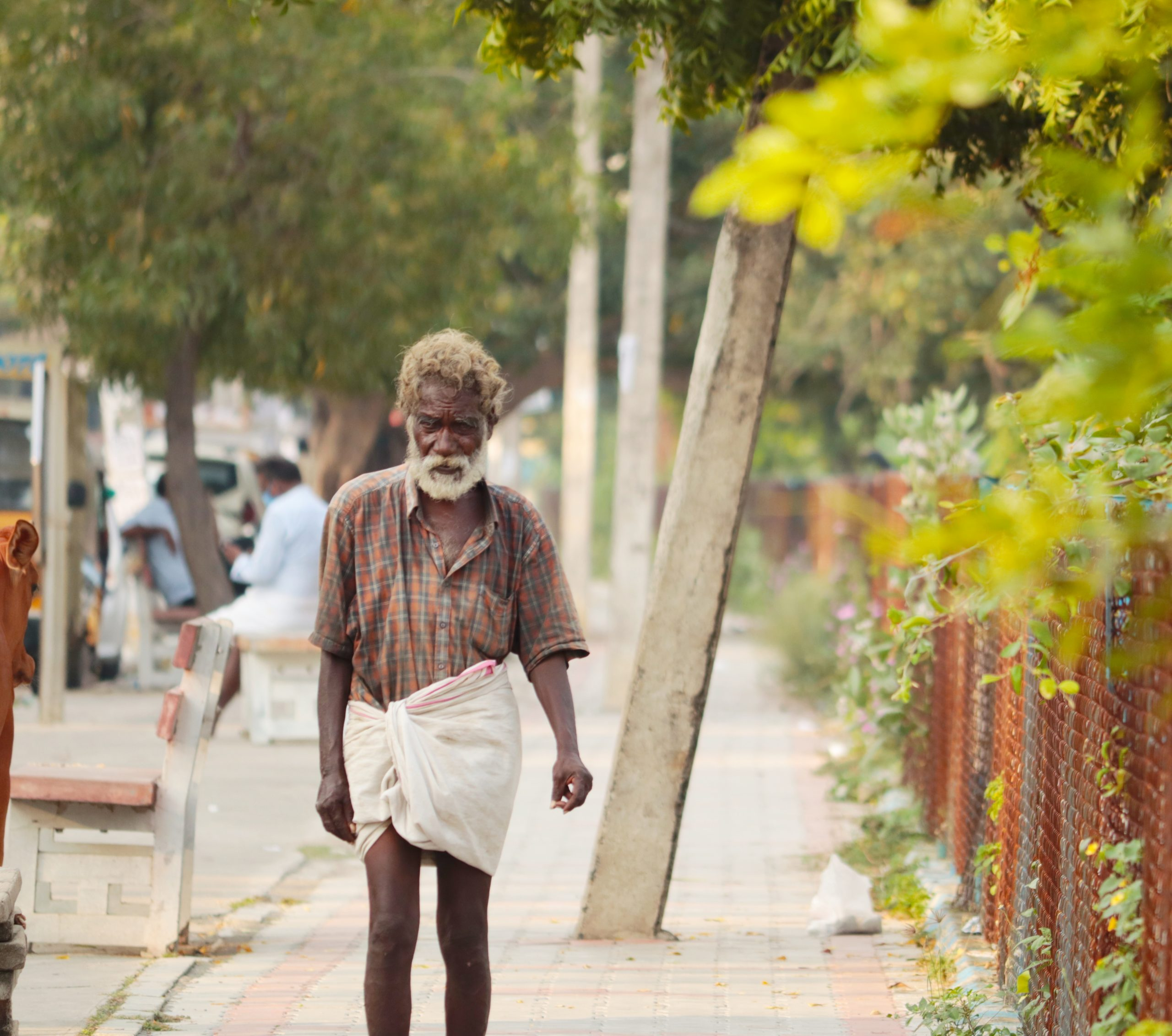 An old man walking on a public place