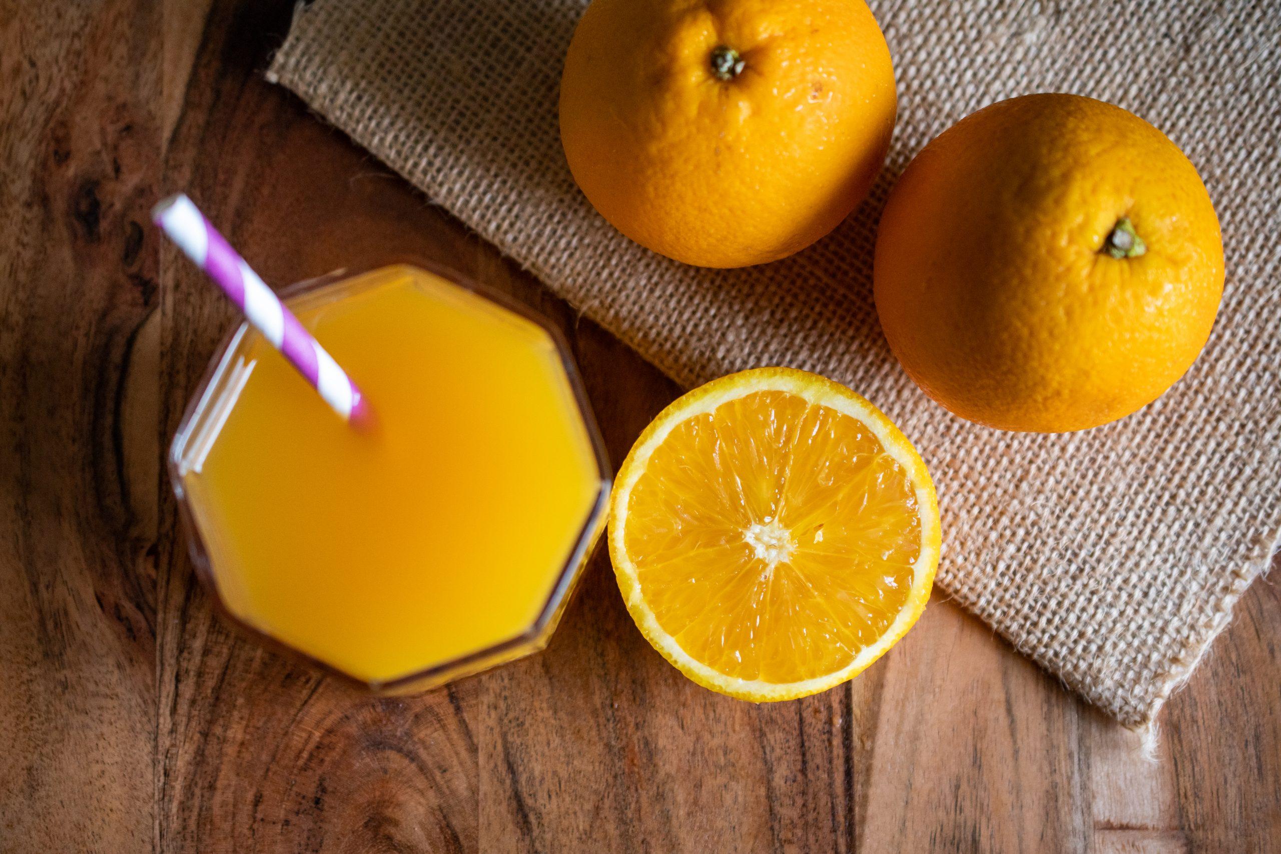 oranges and orange juice in glass