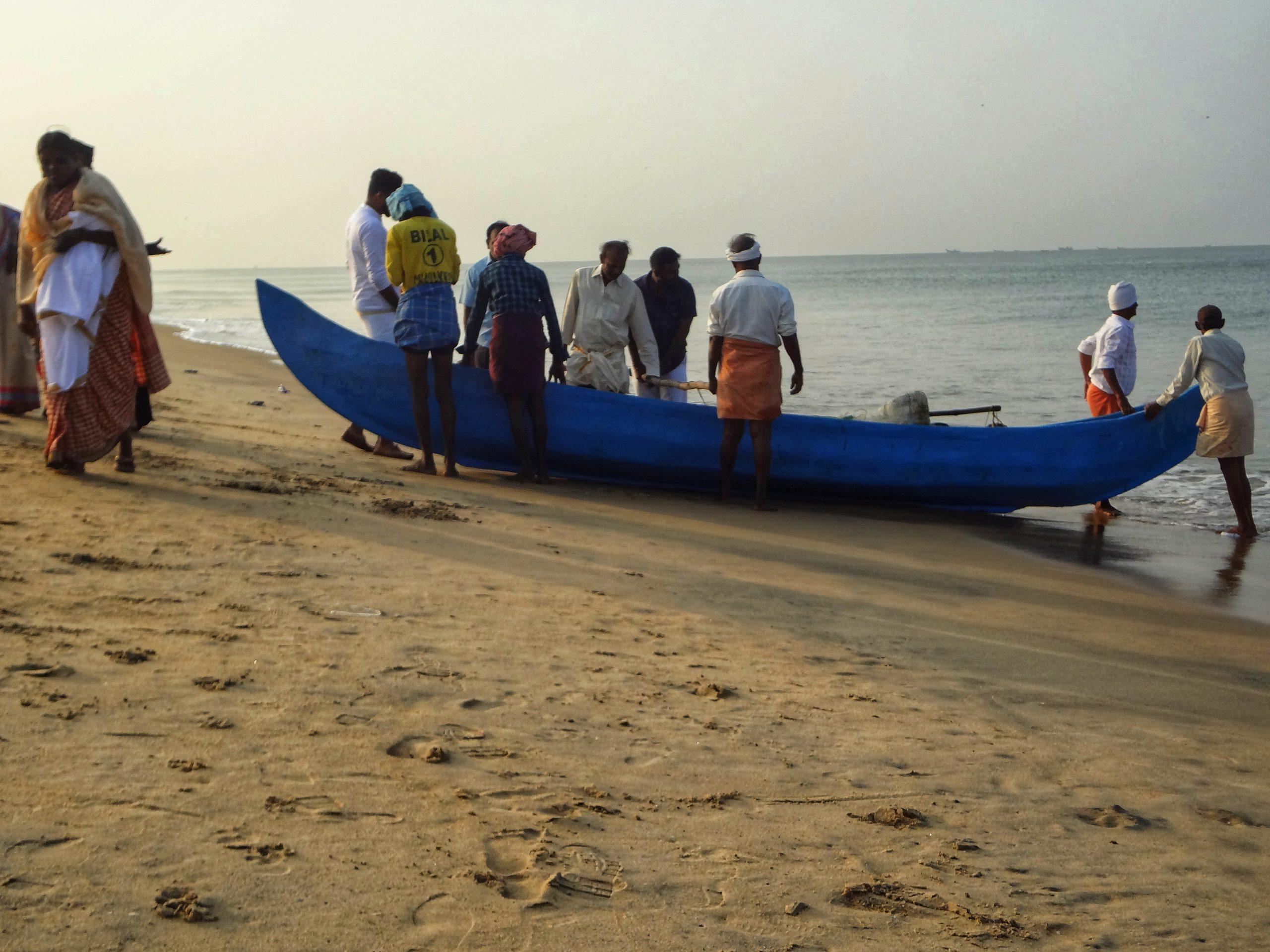 People near a boat