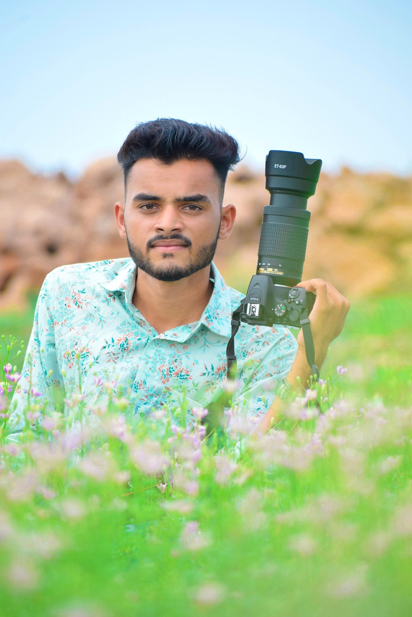 man posing with camera