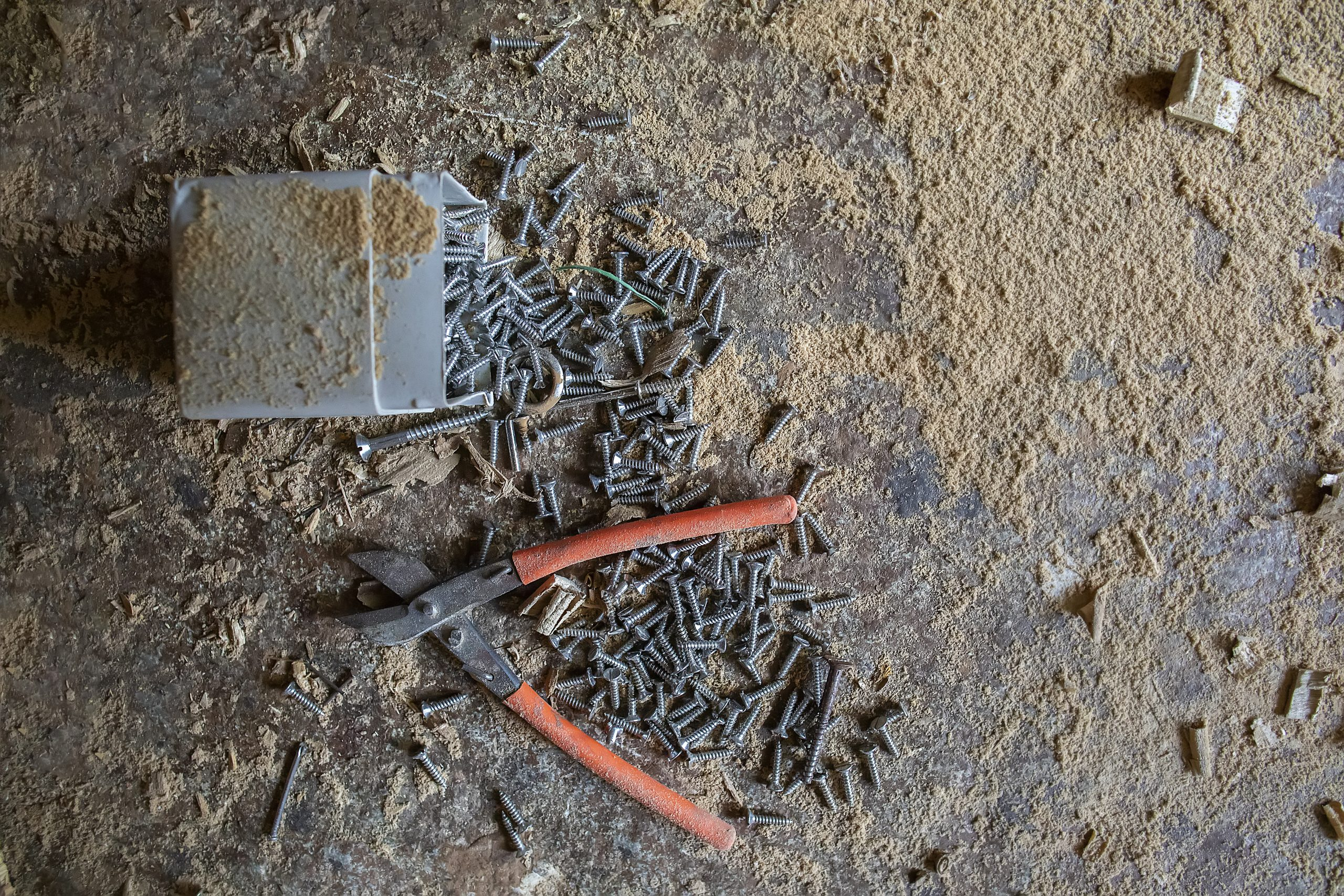 Plier and screws of a carpenter