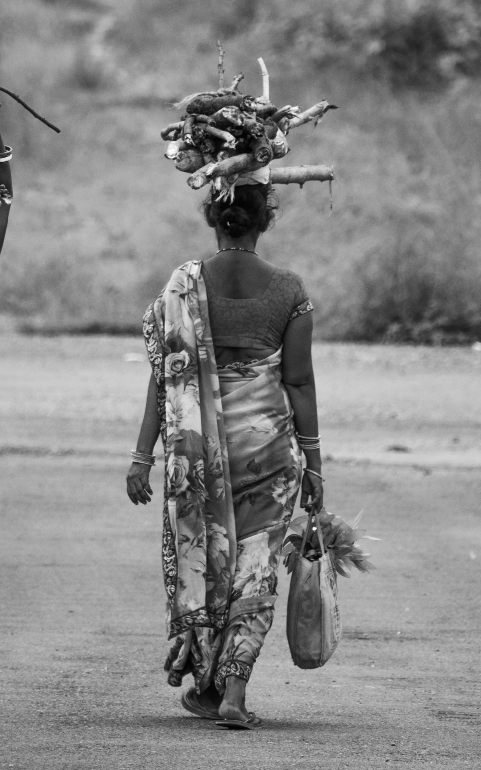 A woman carrying woods