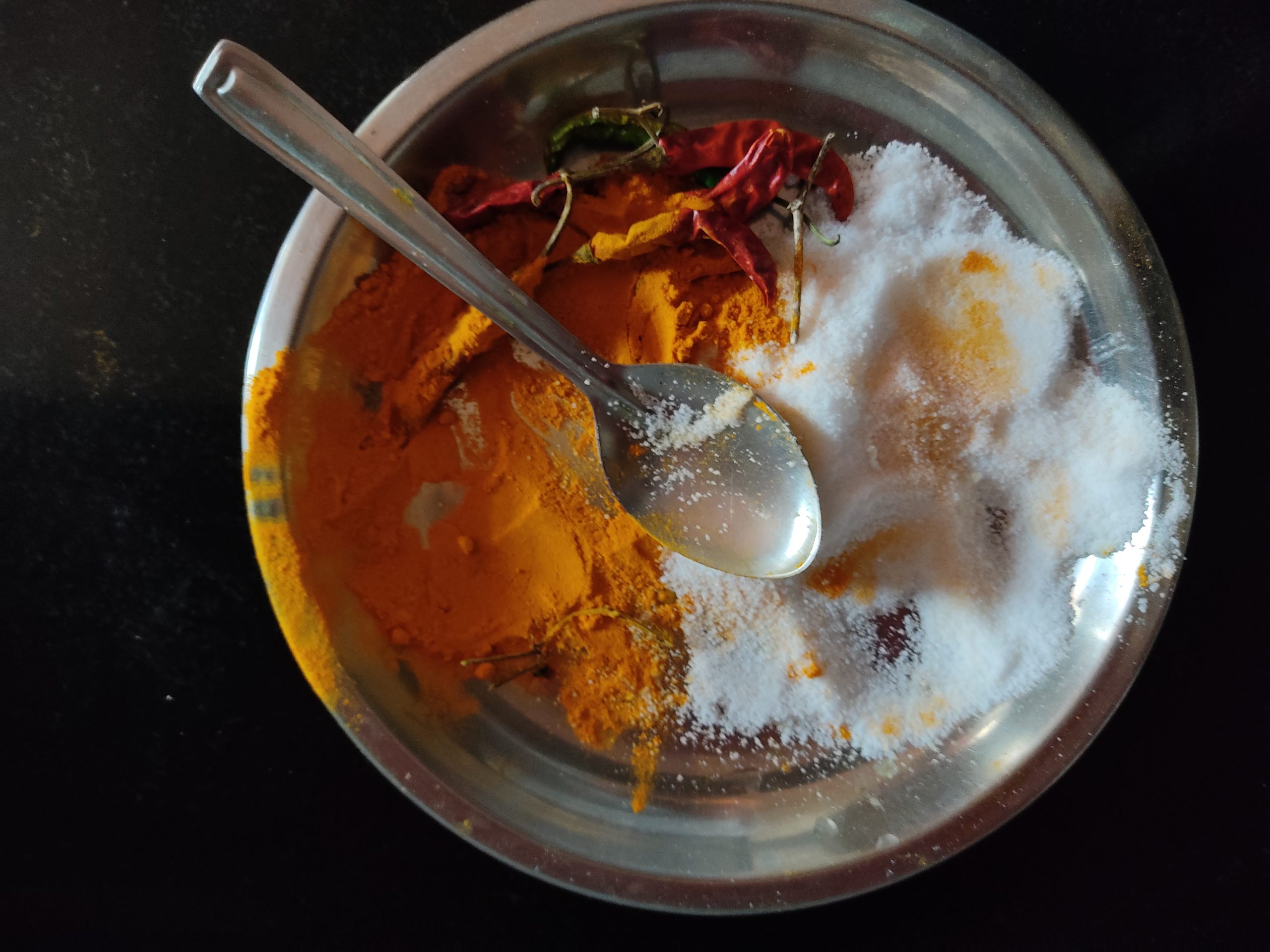 Salt and turmeric in a plate