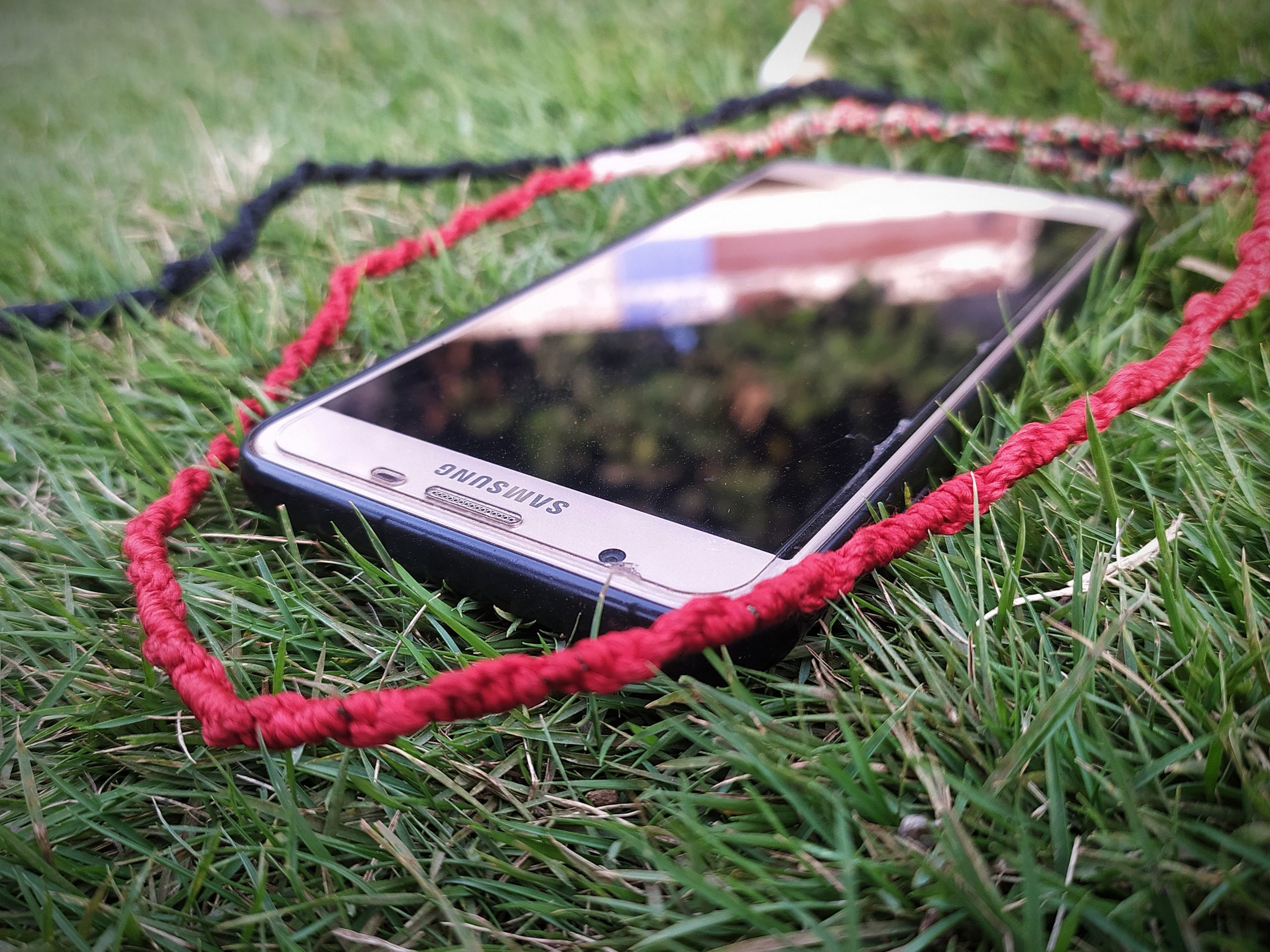 A mobile phone on grass
