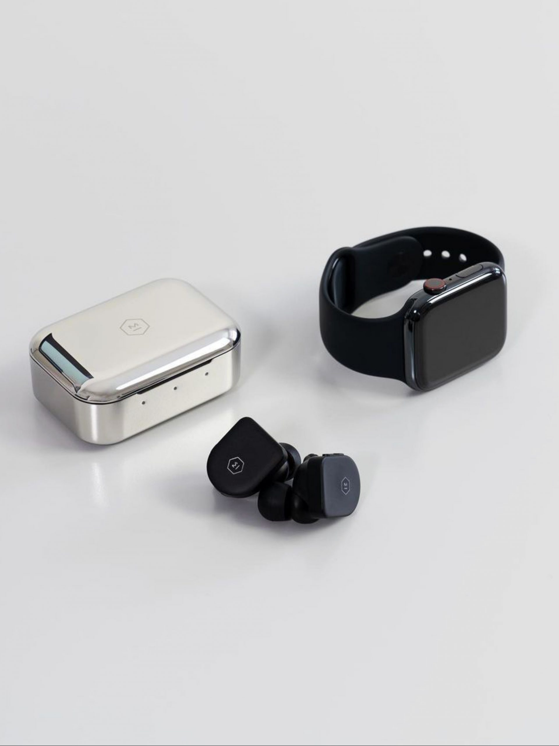 A smartwatch and earpods
