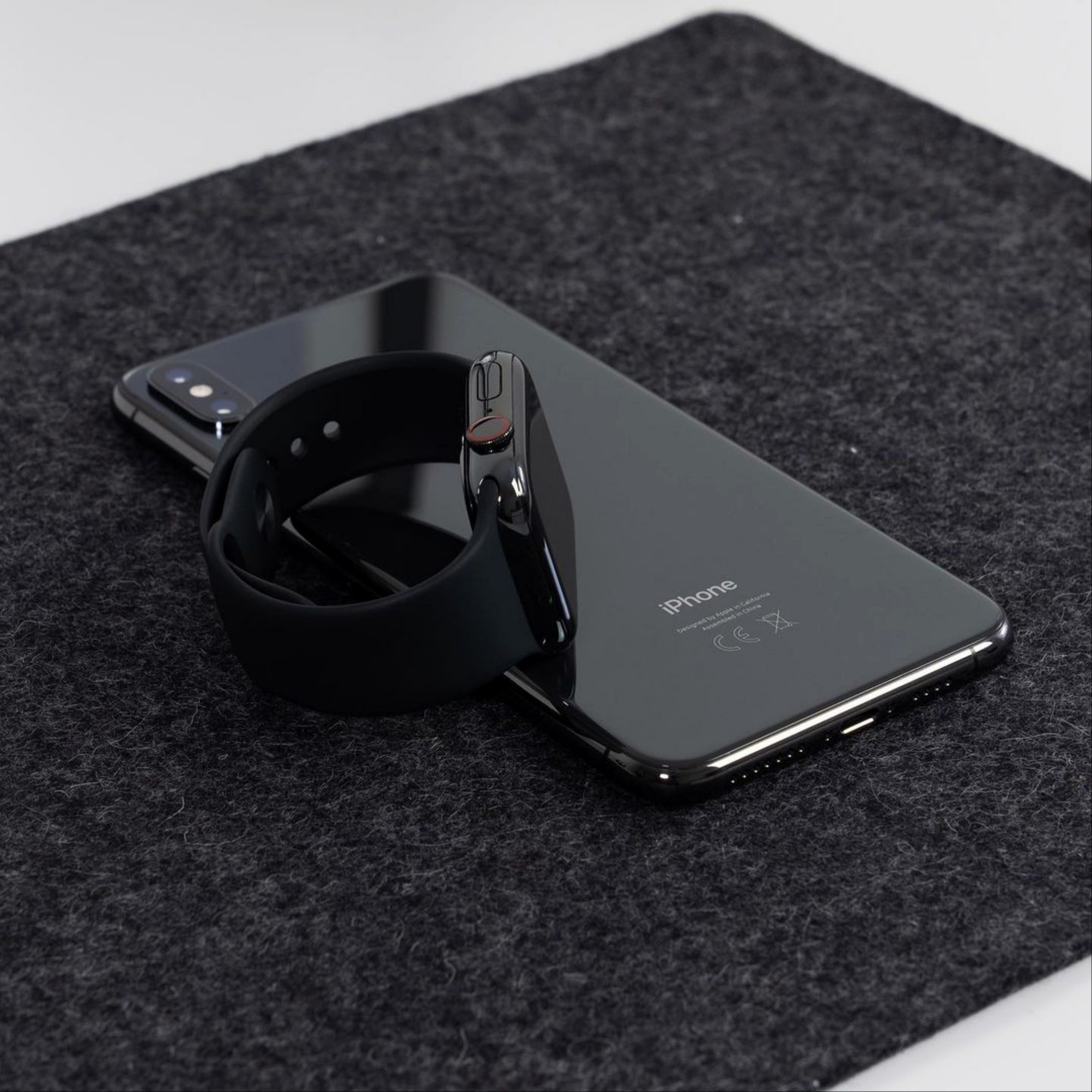A smartwatch and iPhone