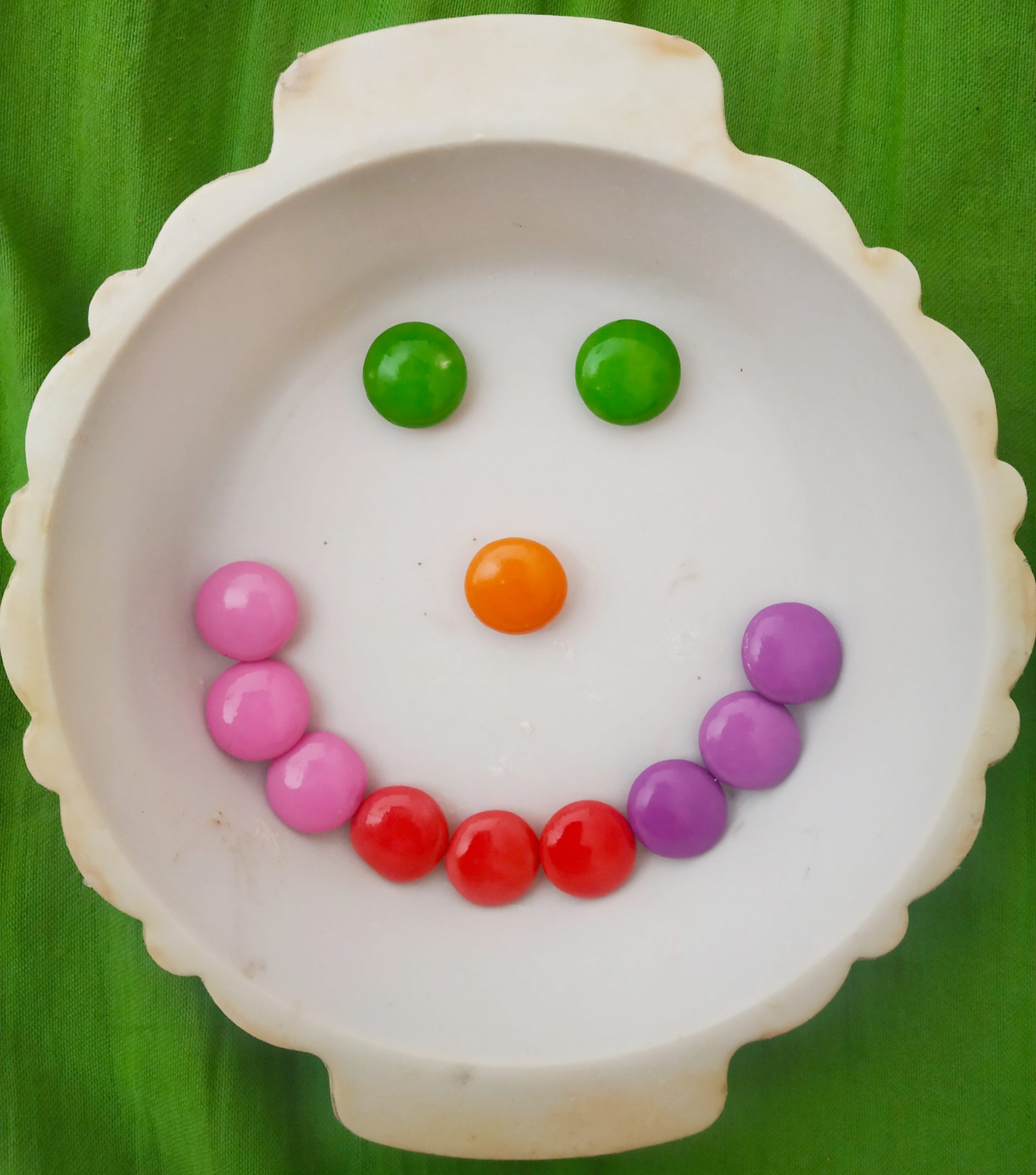 Smiley made with candies and plate