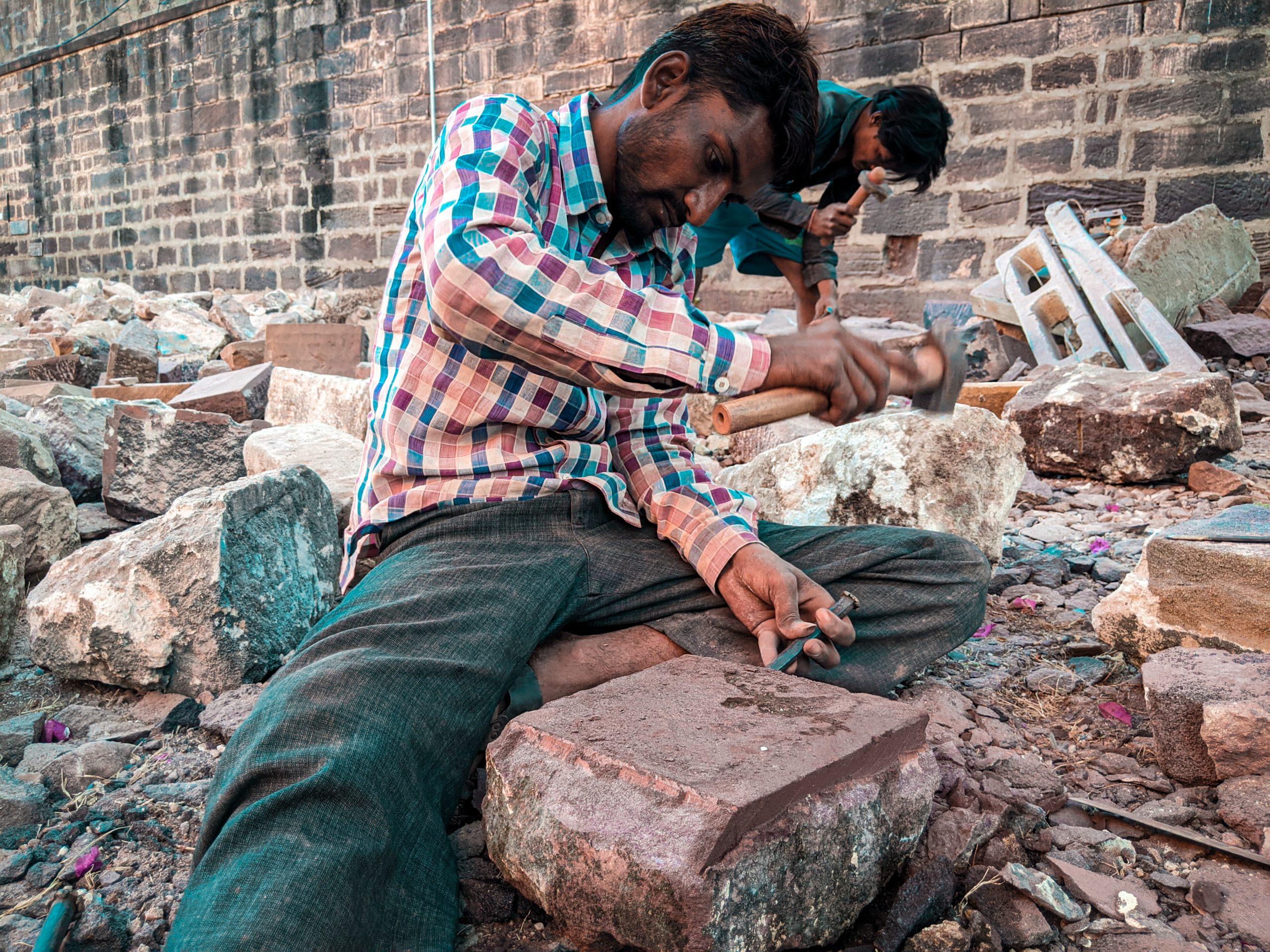 Men dressing stones