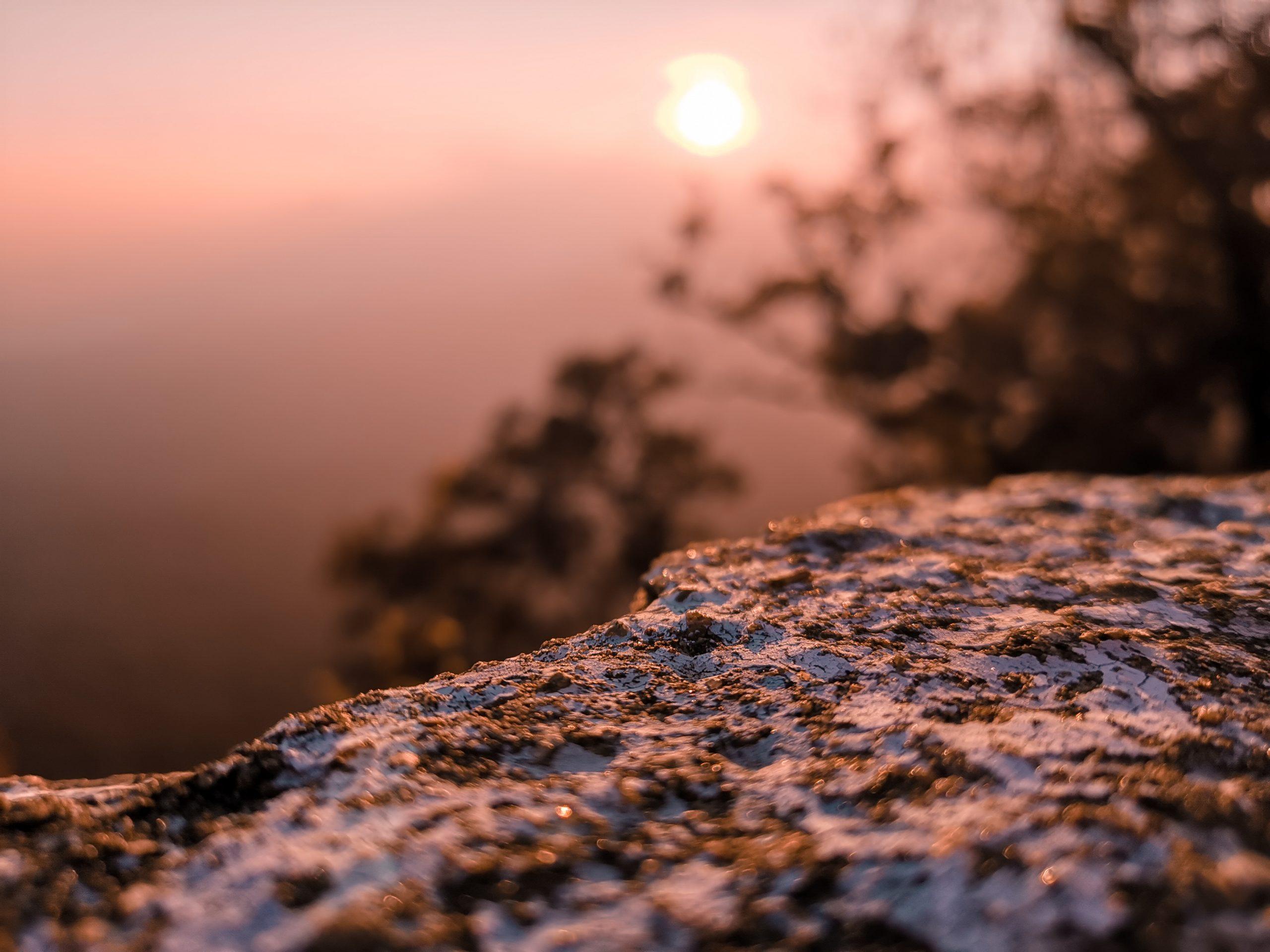 Sunrise through a hill