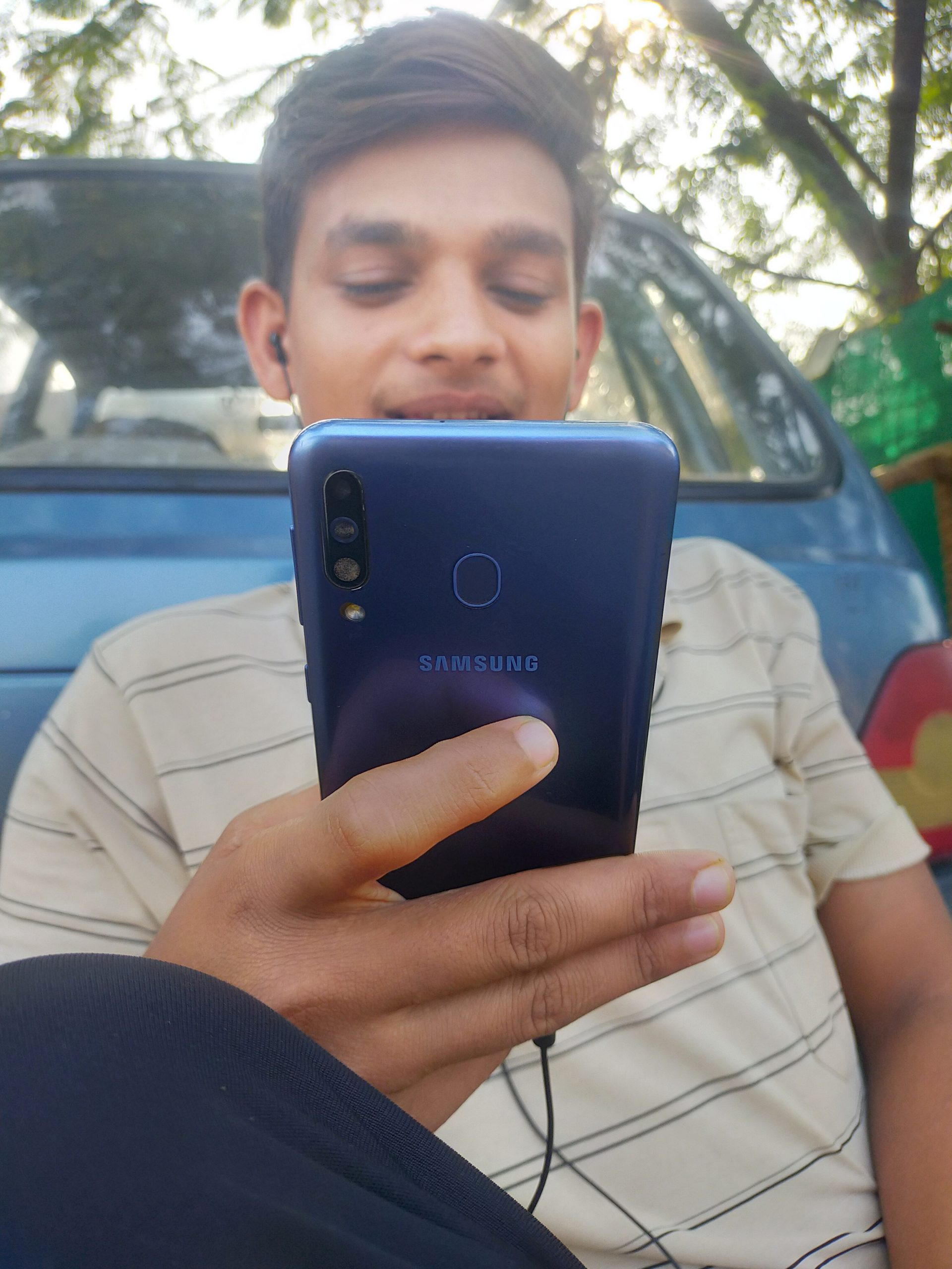 A boy using mobile phone