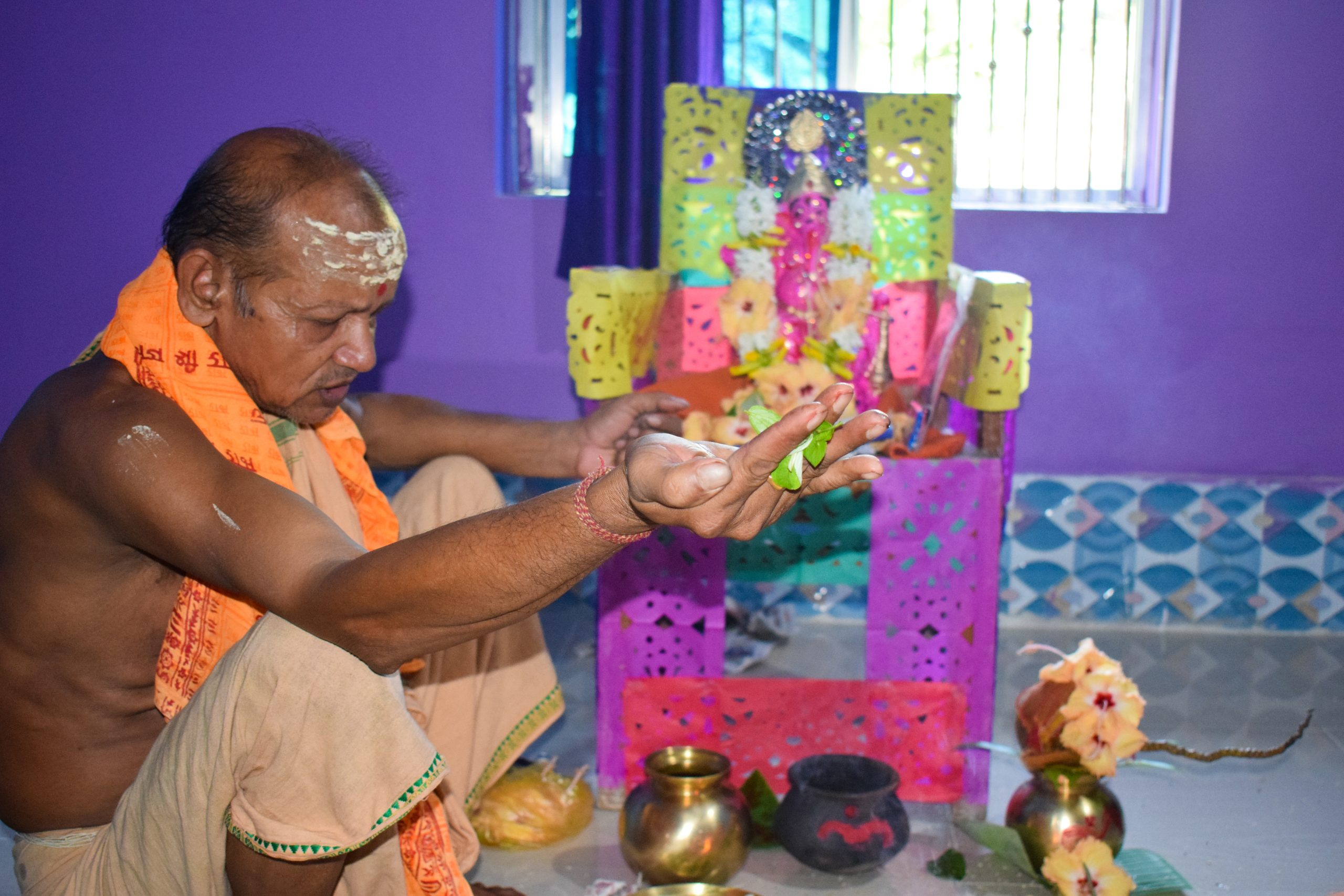 A priest worshiping in a temple