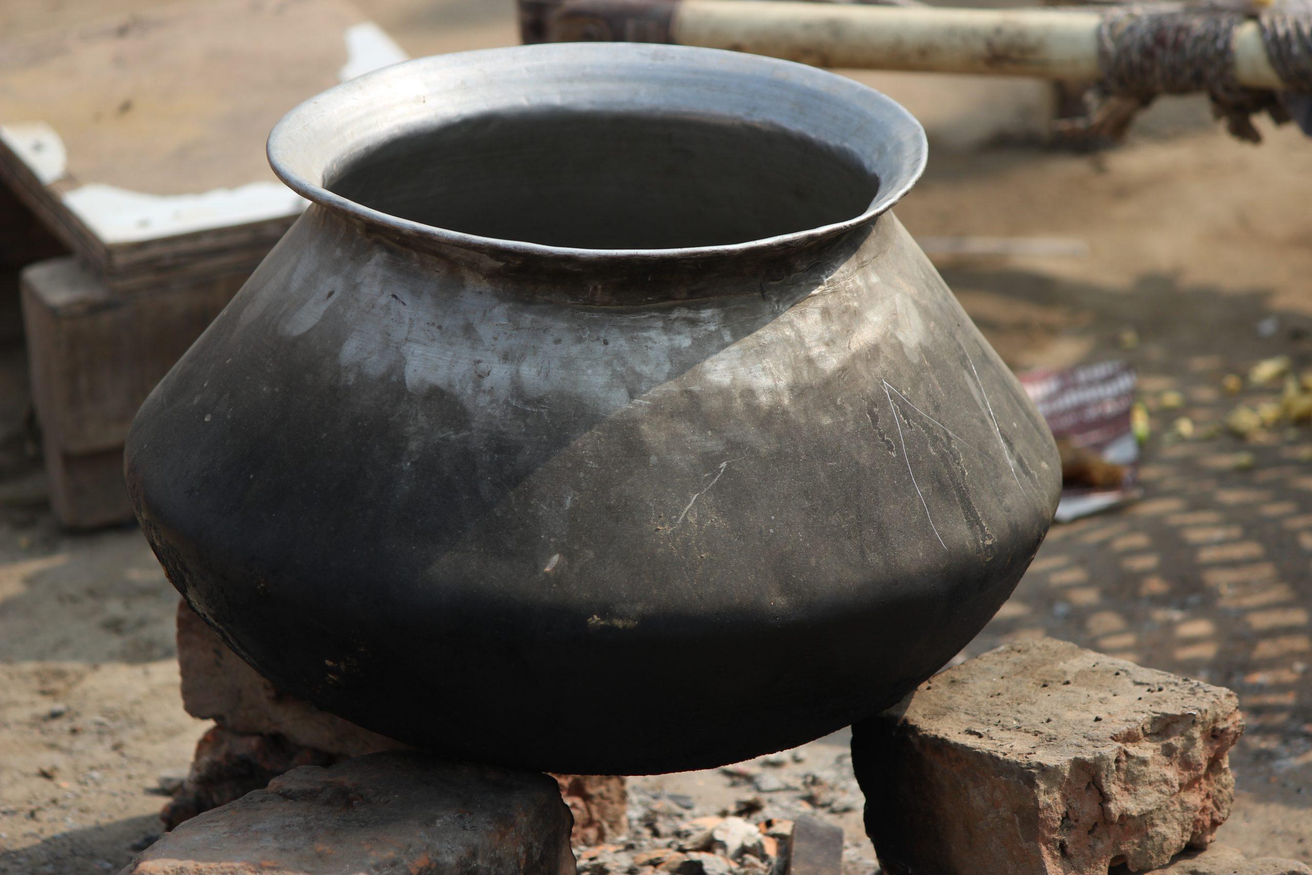 An aluminum pot on stove