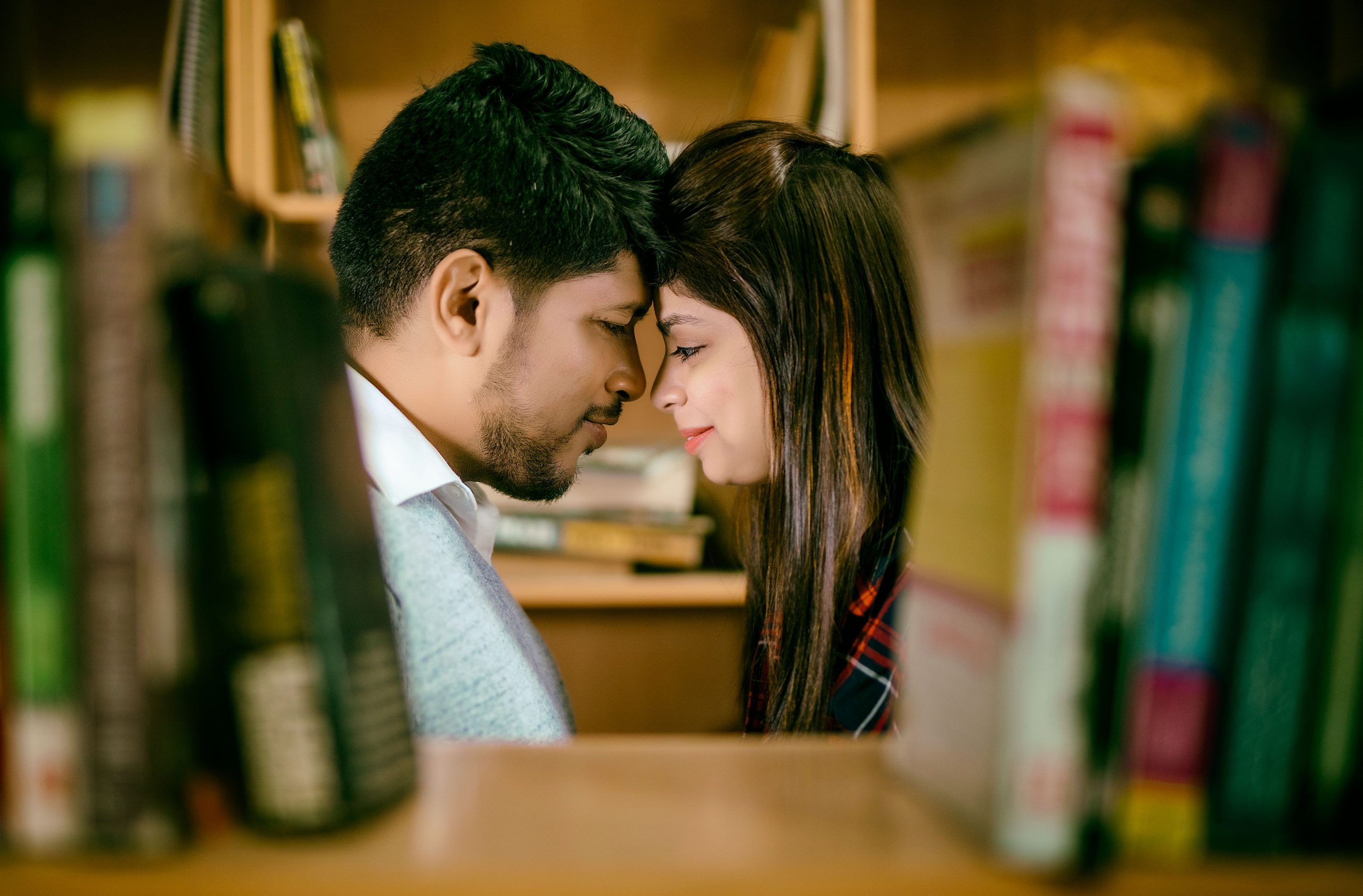 couple posing in library