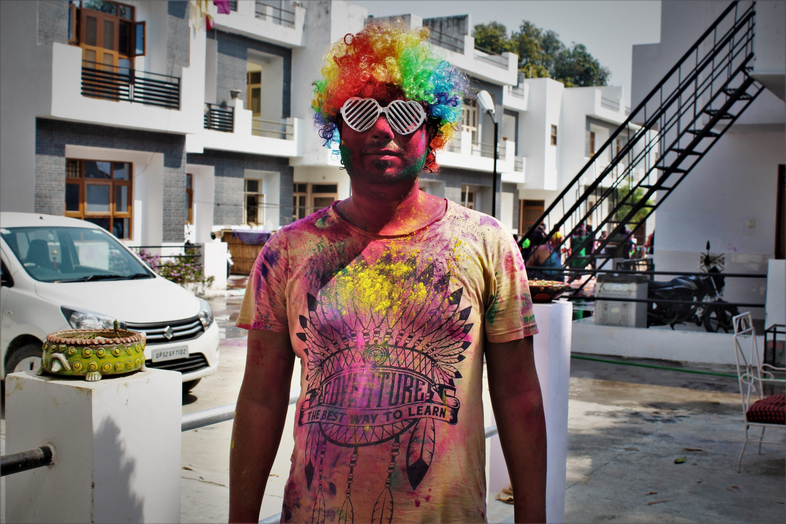 Man posing in society after playing Holi