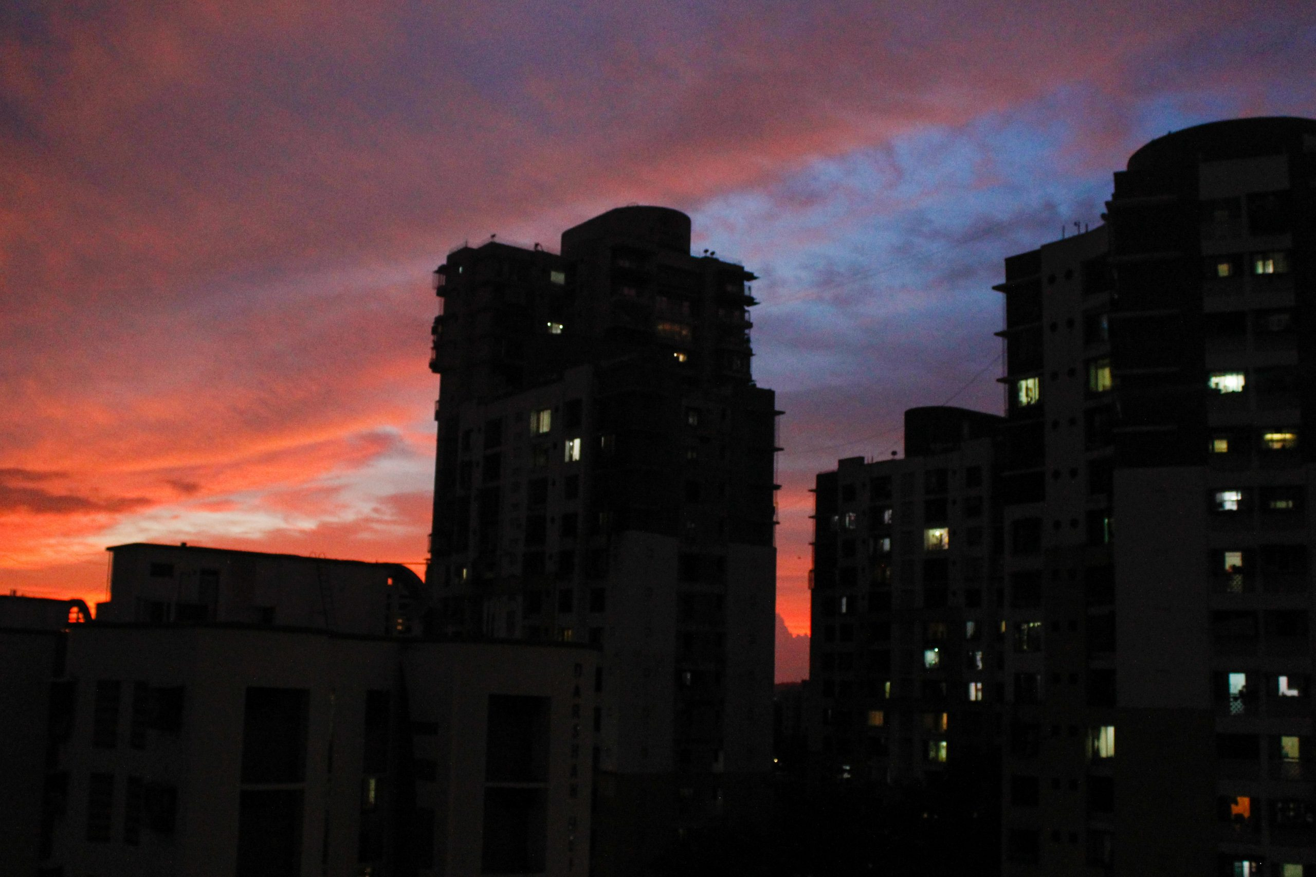 silhouette of buildings against the evening sky