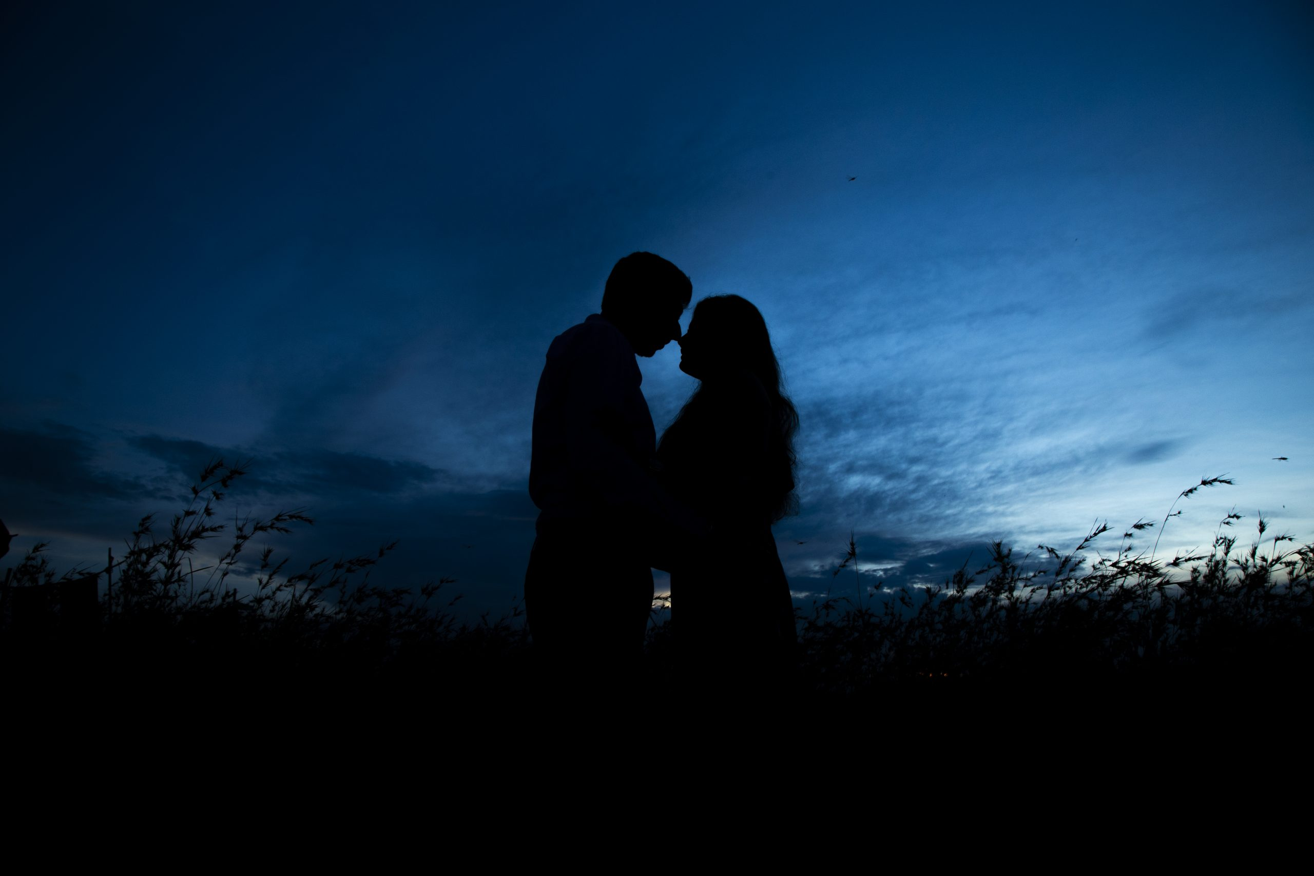 silhouette of couple at twilight