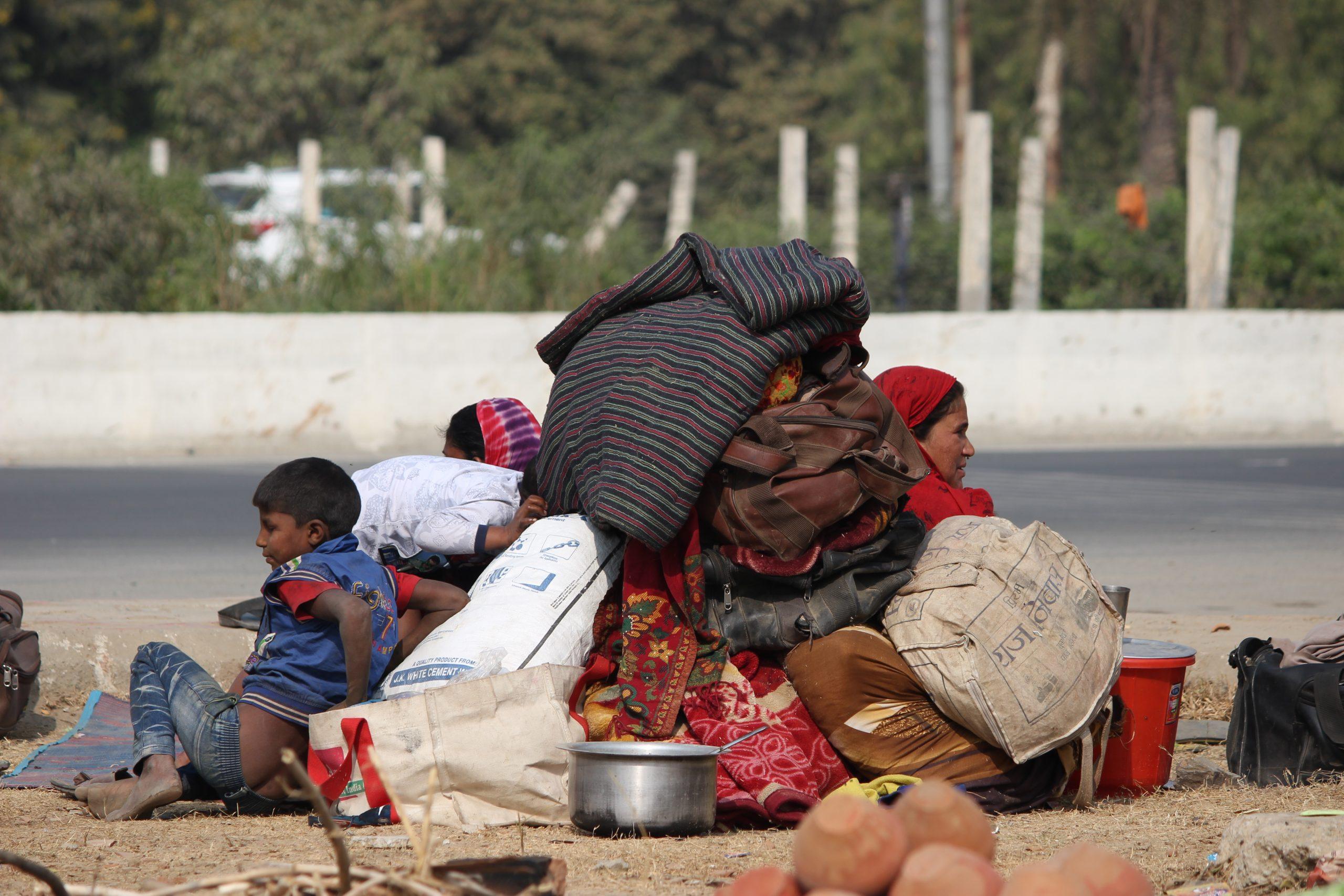 Poor people at roadside