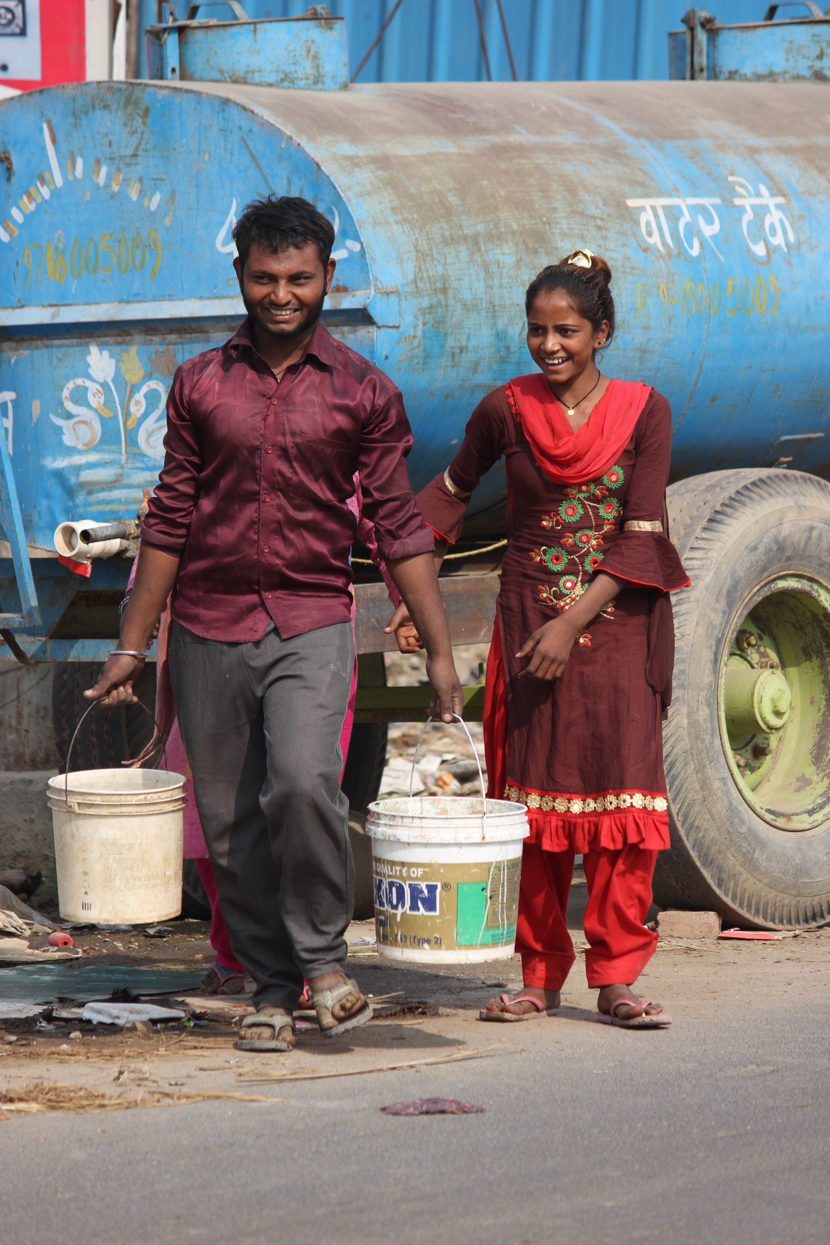 People near a watertank