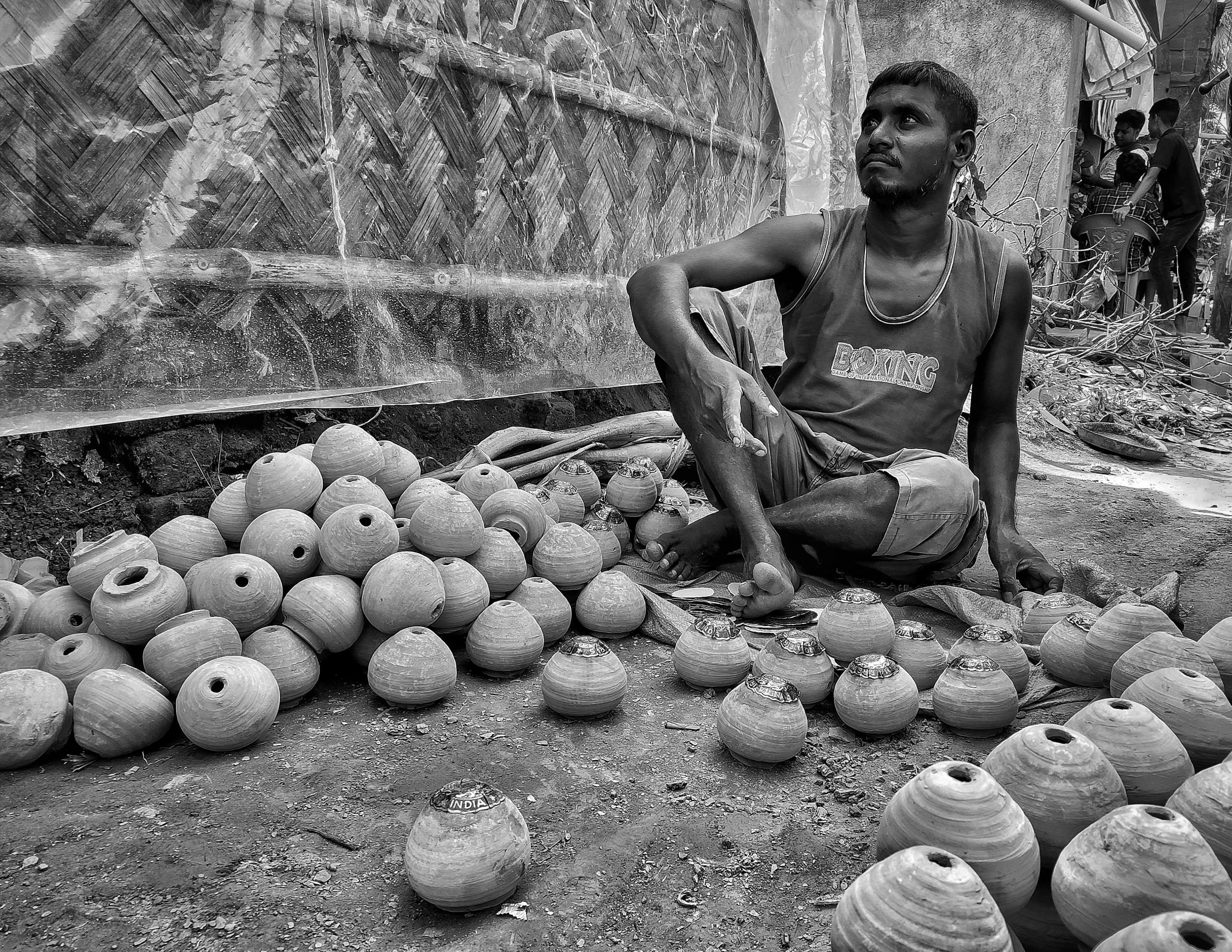 A man selling clay pots