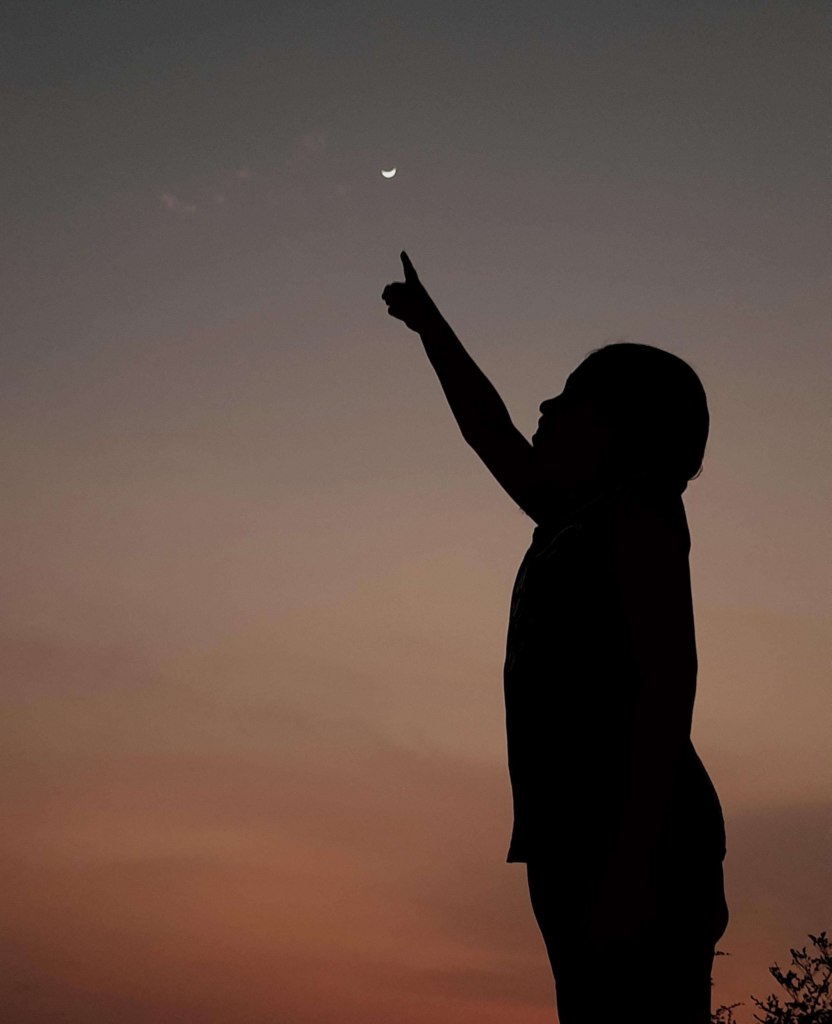 man posing under the moon