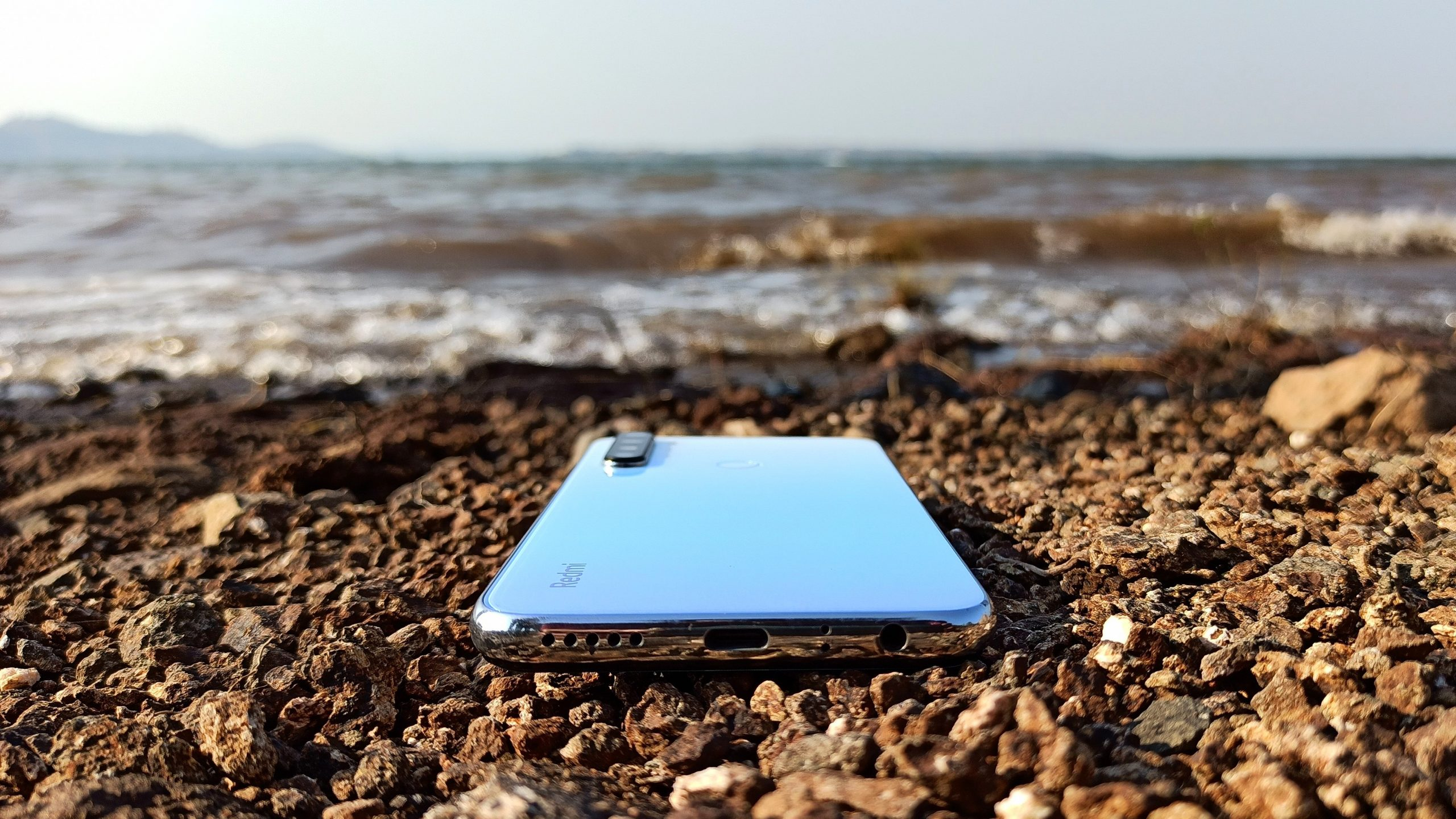 A mobile phone on a beach