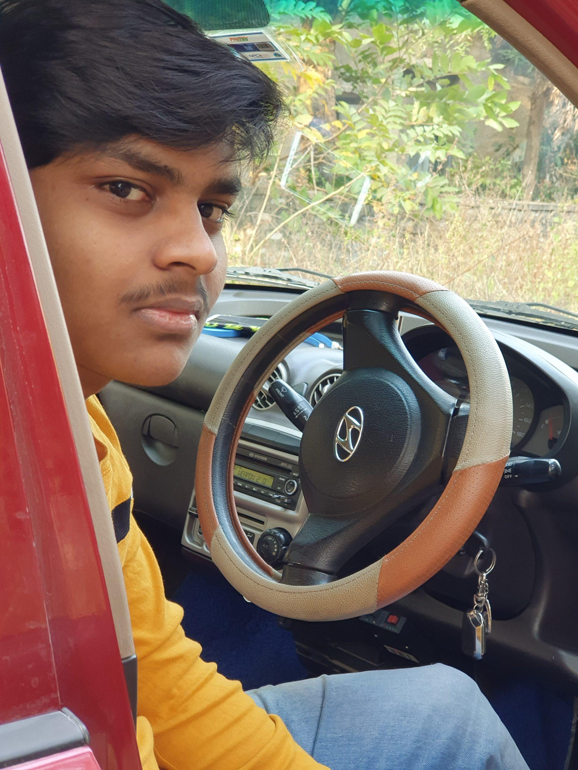 A boy in a car