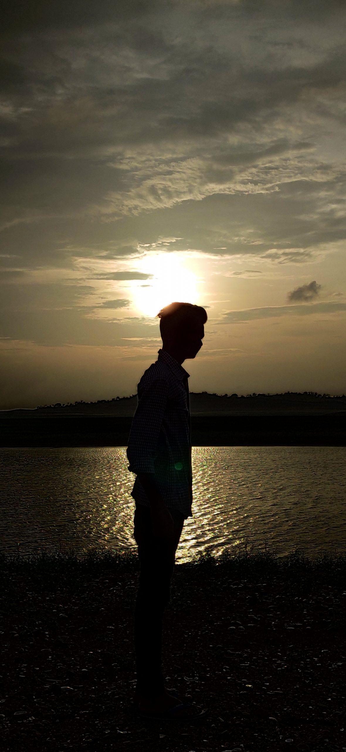 A boy, lake and sunset