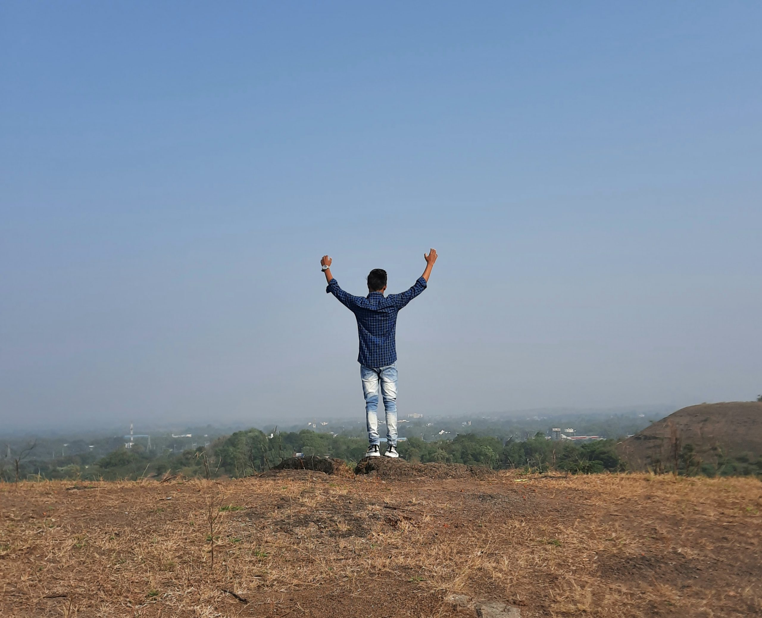 Boy on top of mountain