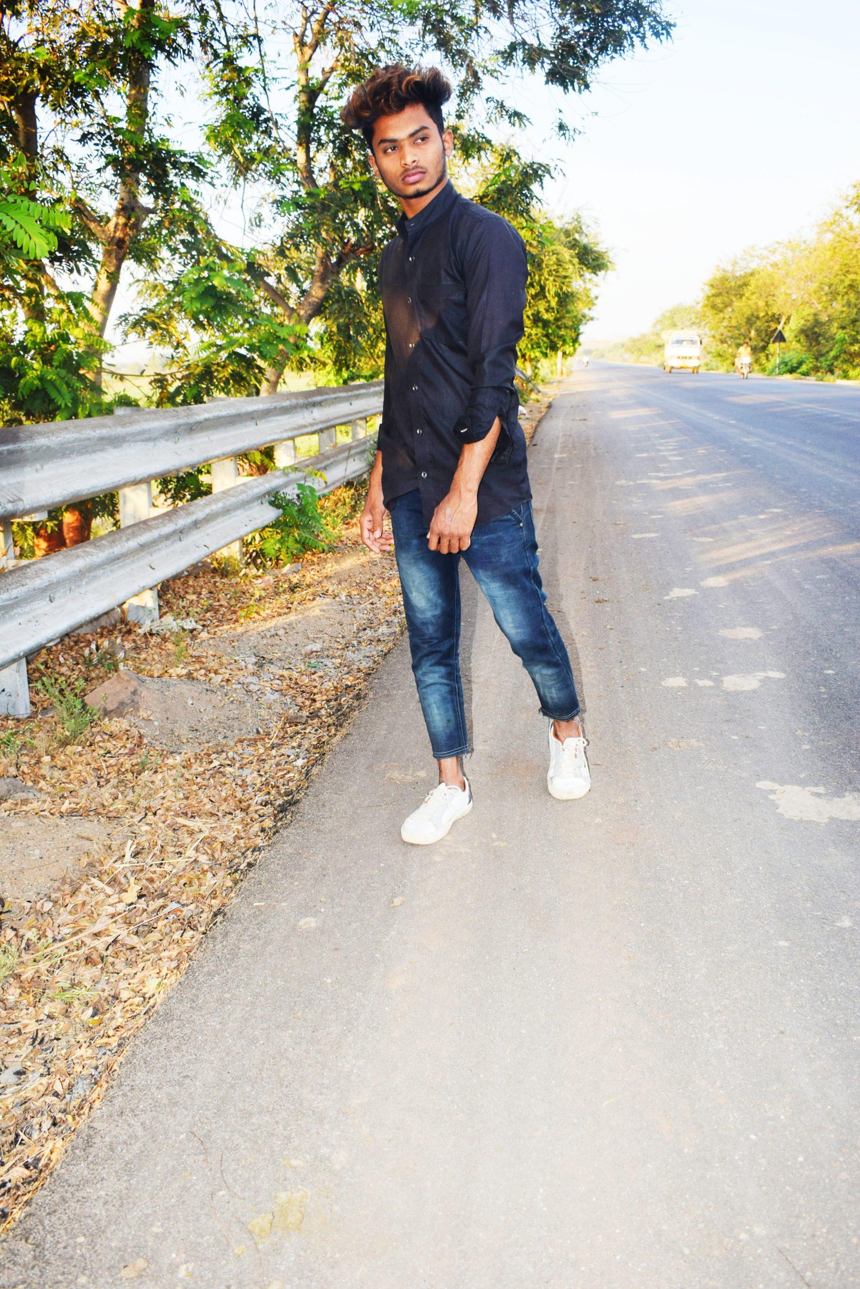 A boy posing on a road
