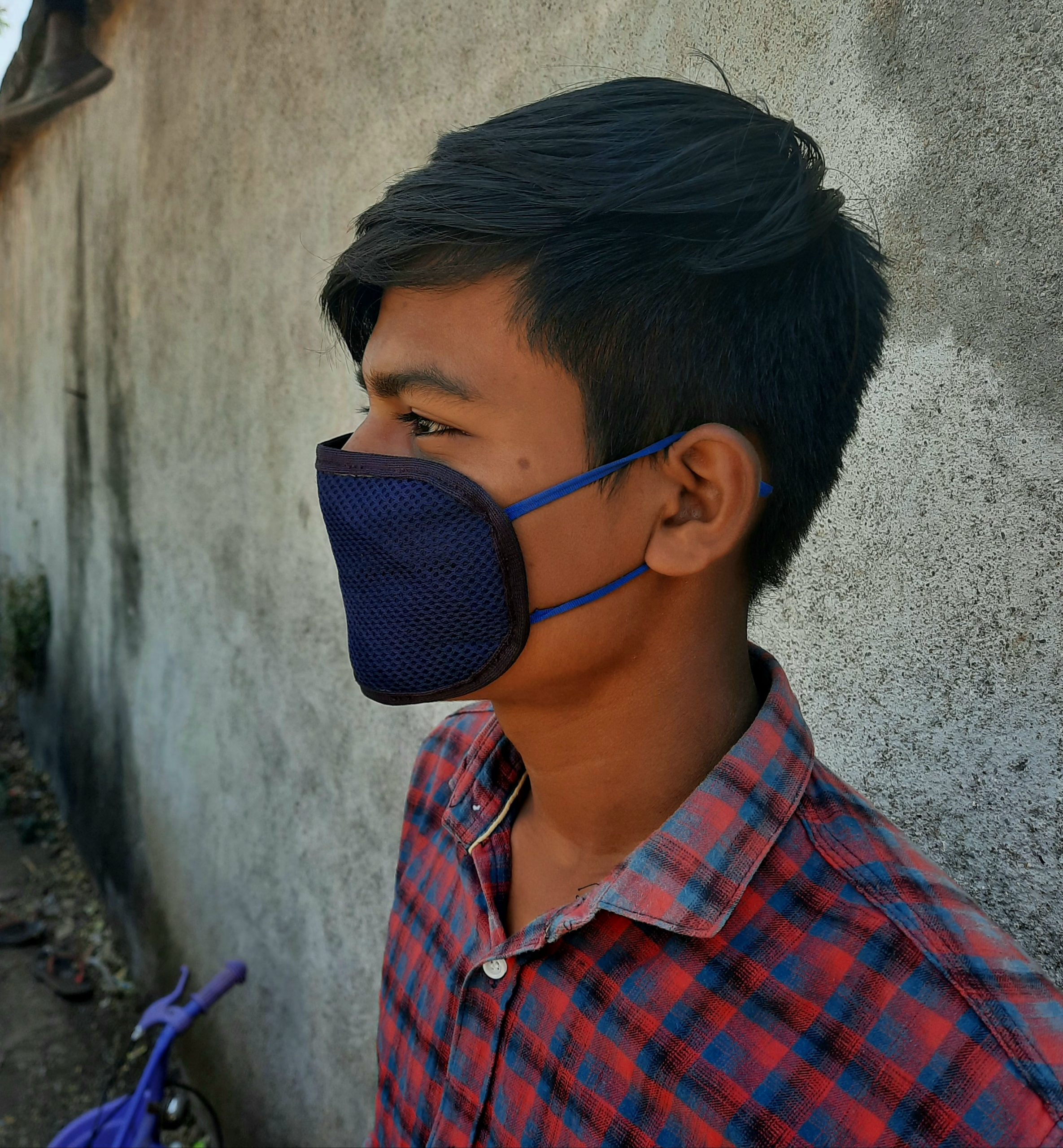 A boy with face mask