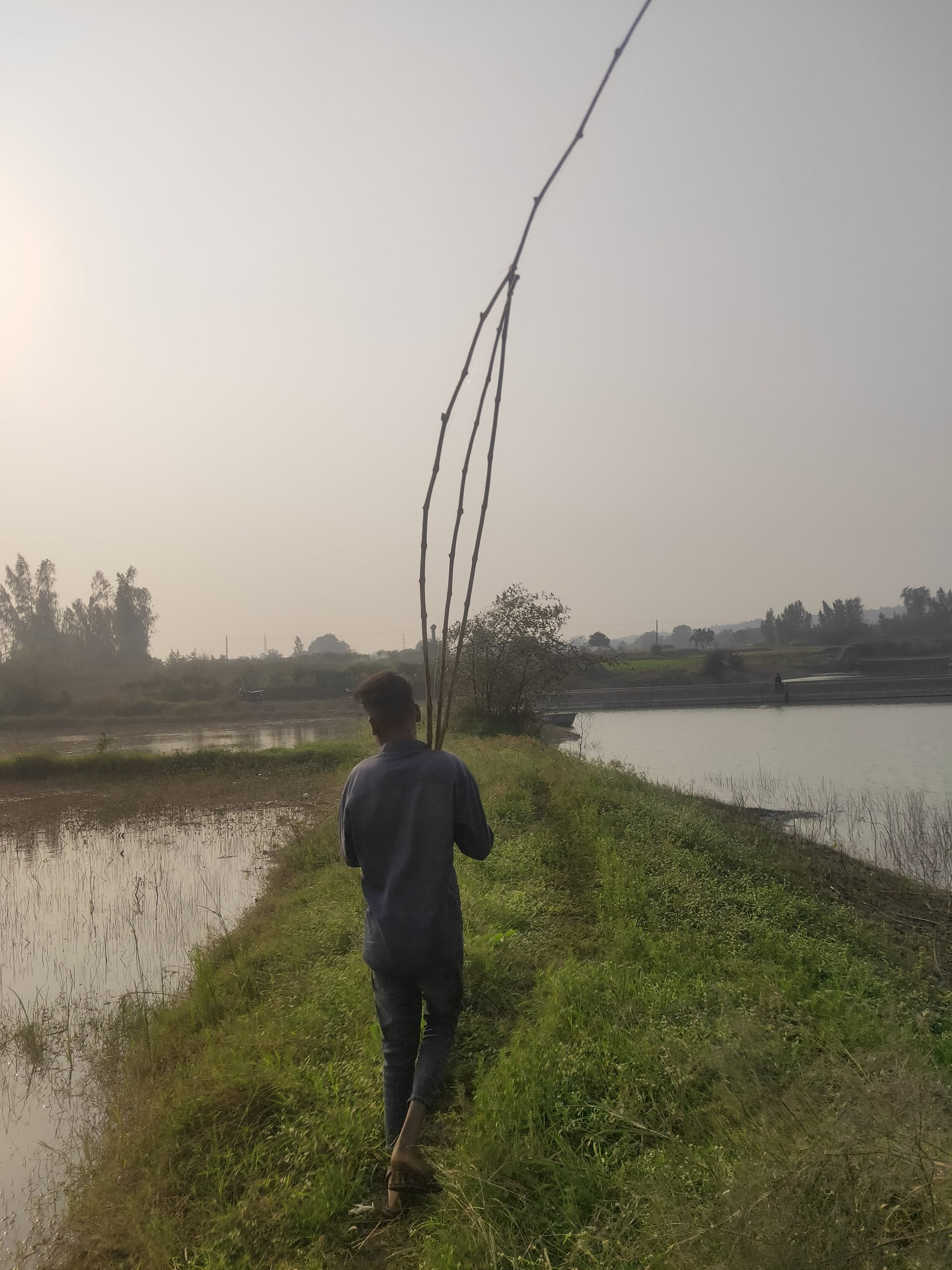 A boy with fishing rods