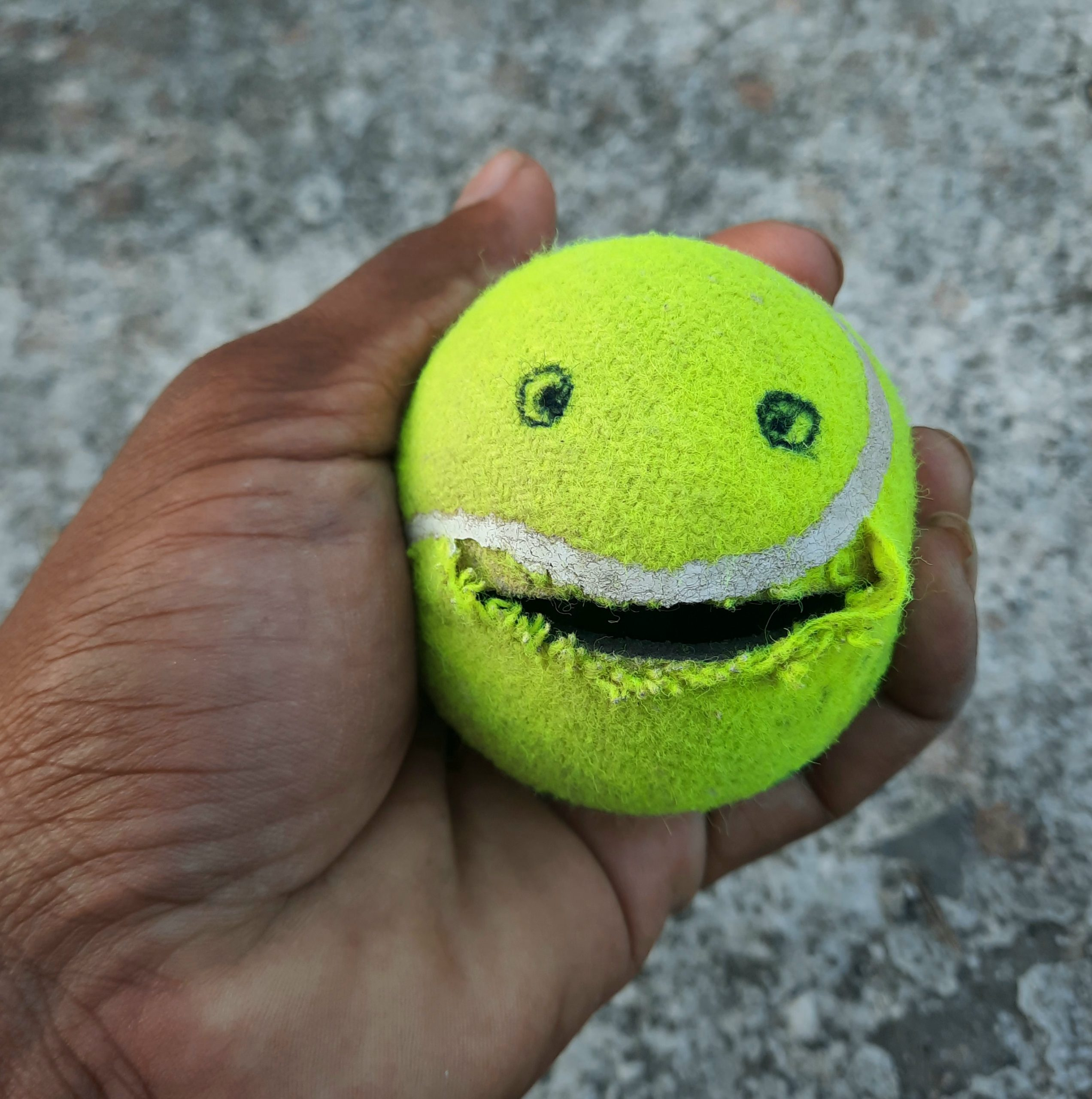 Making emoji with tennis ball