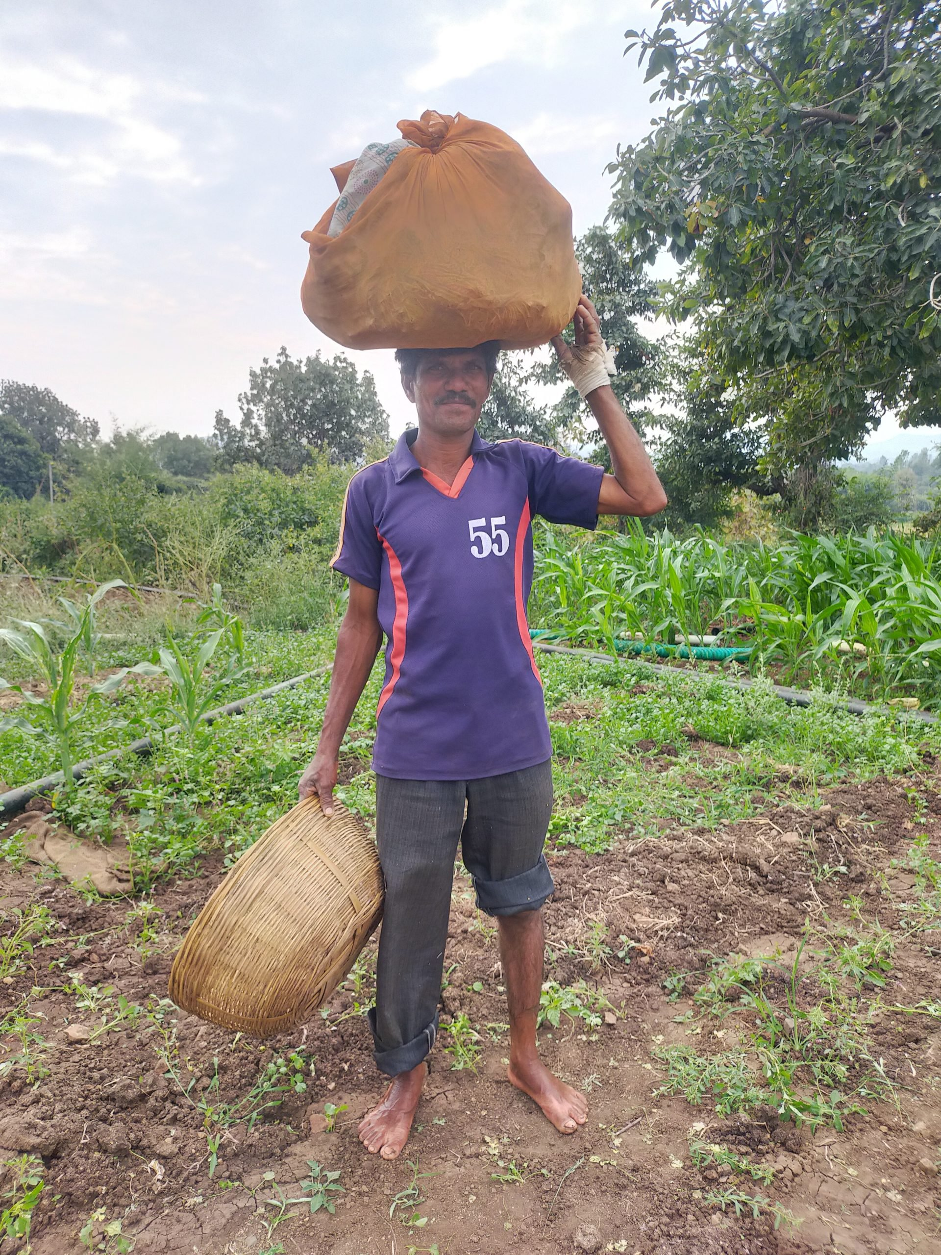 A farmer carrying load