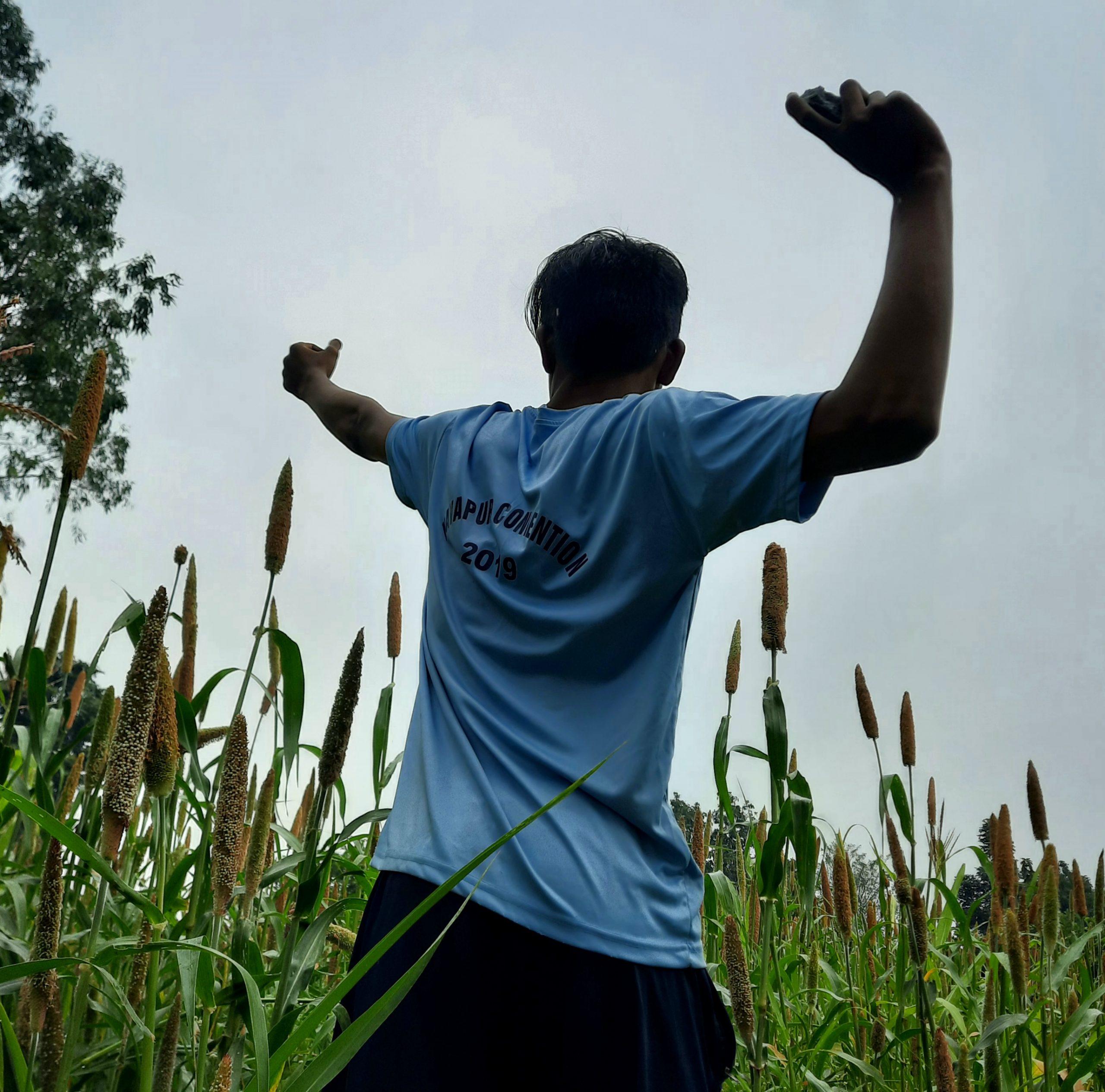 A farmer throwing stone