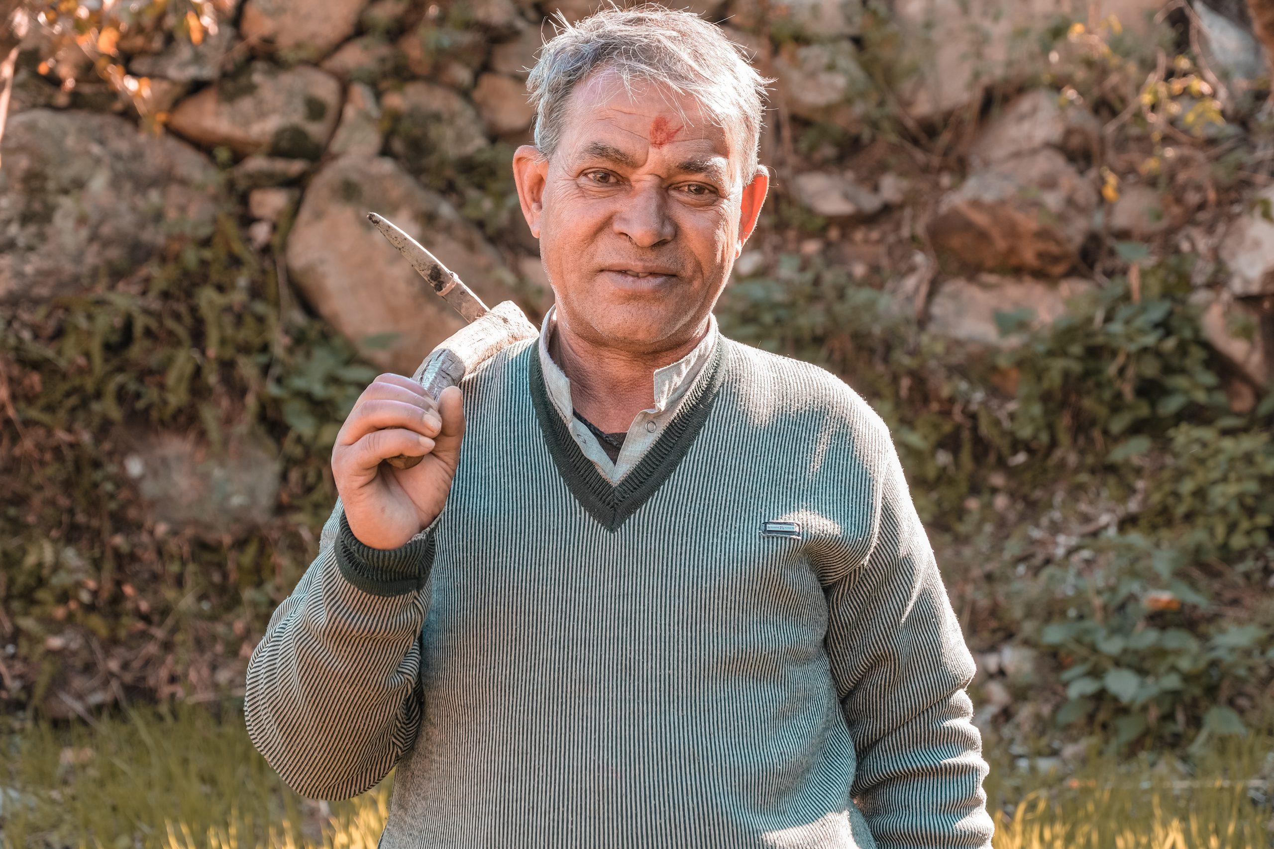 A farmer with a tool