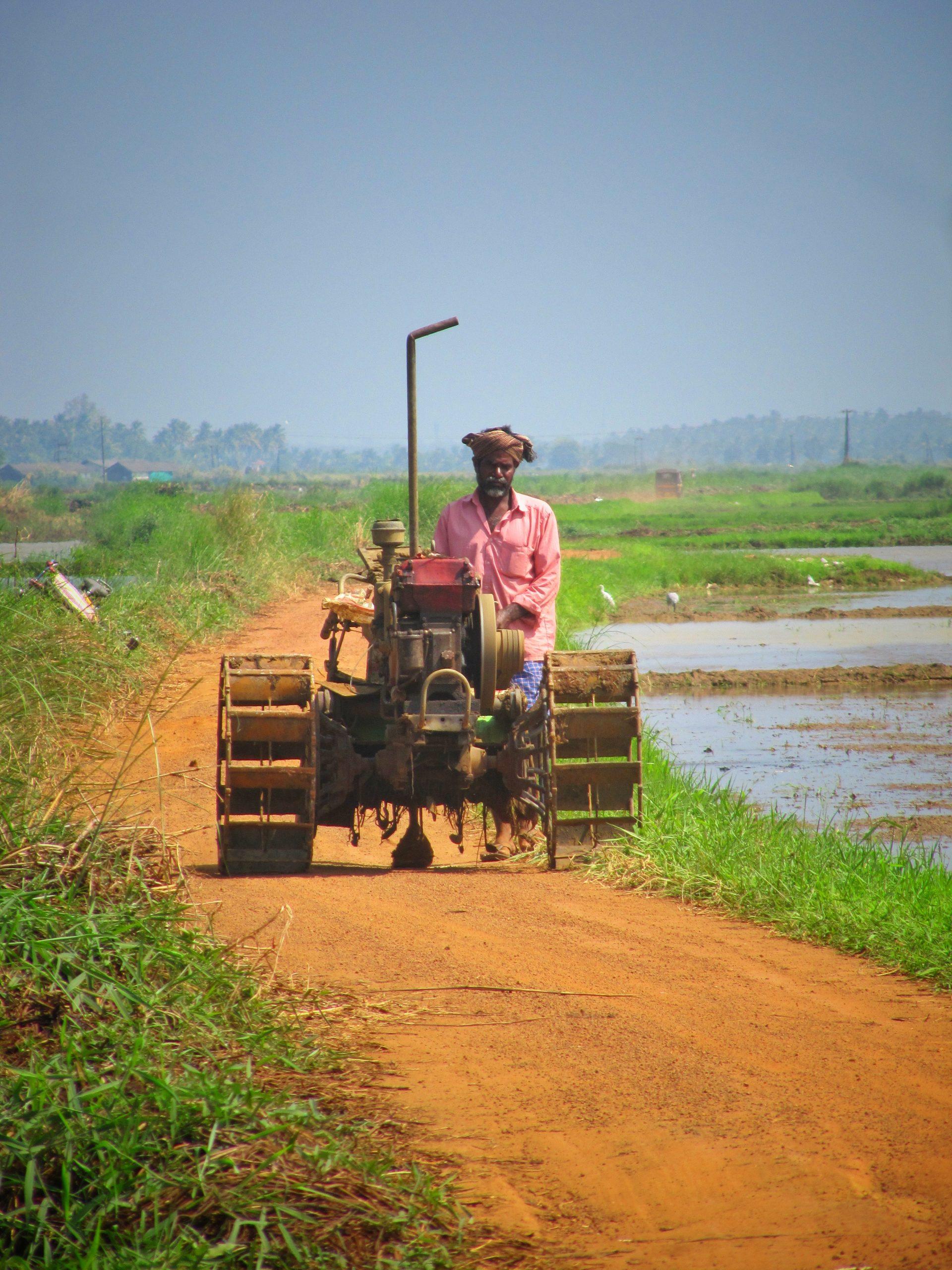 A farmer with farming machine