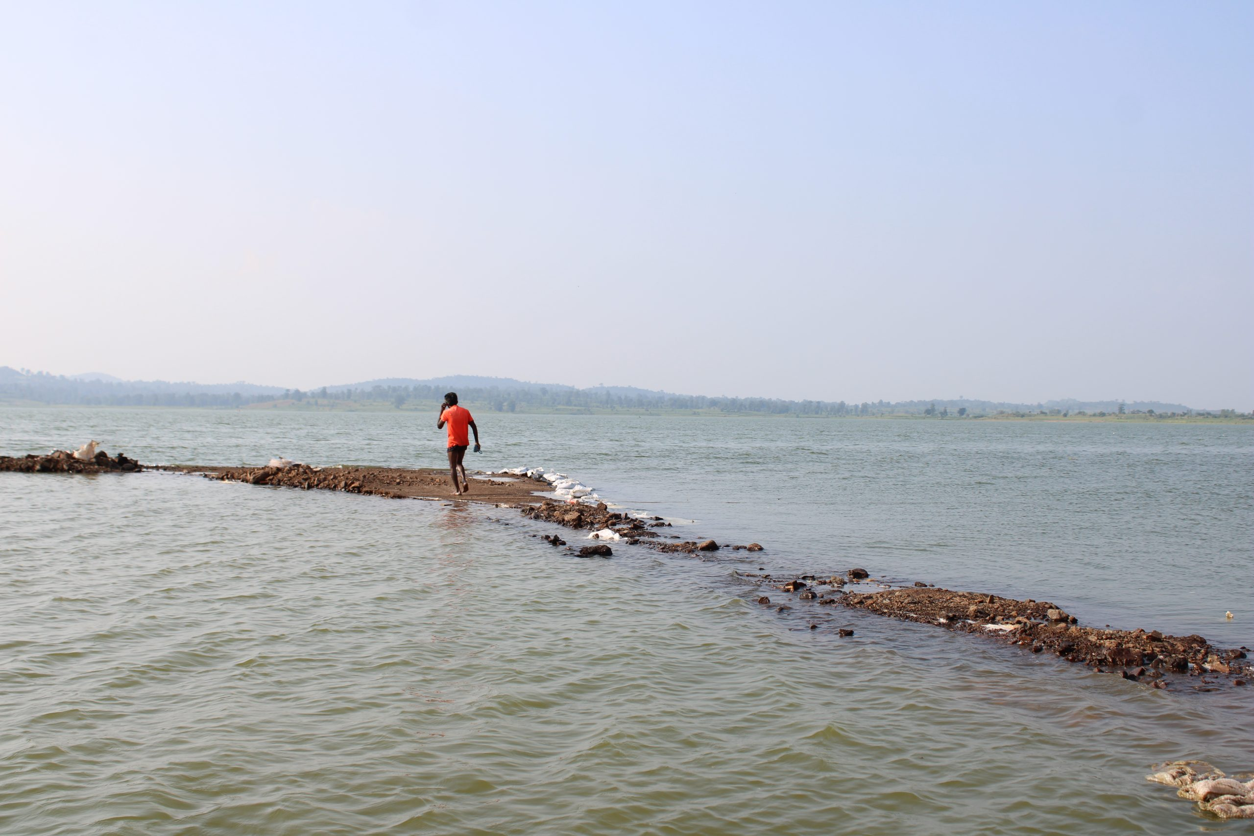 A fisherman at a beach