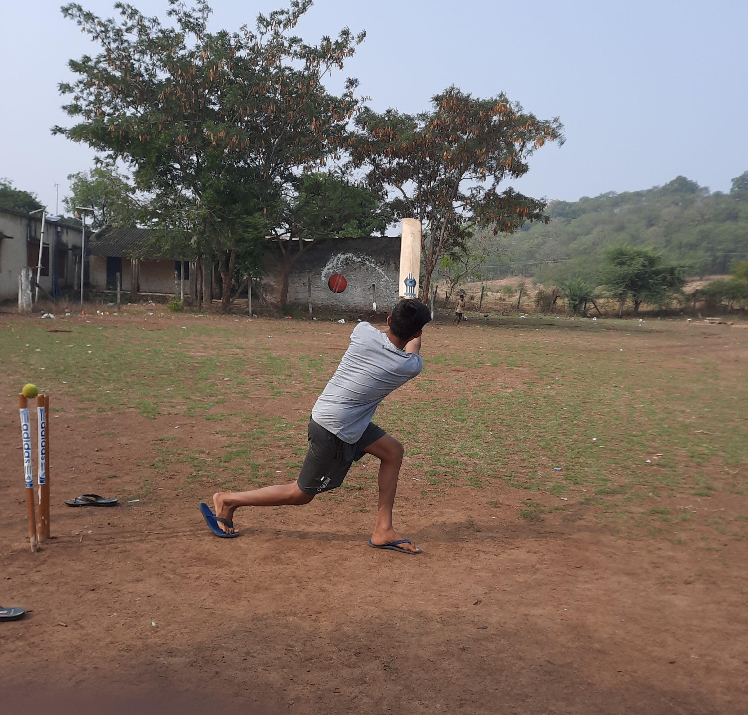 A local boy playing cricket