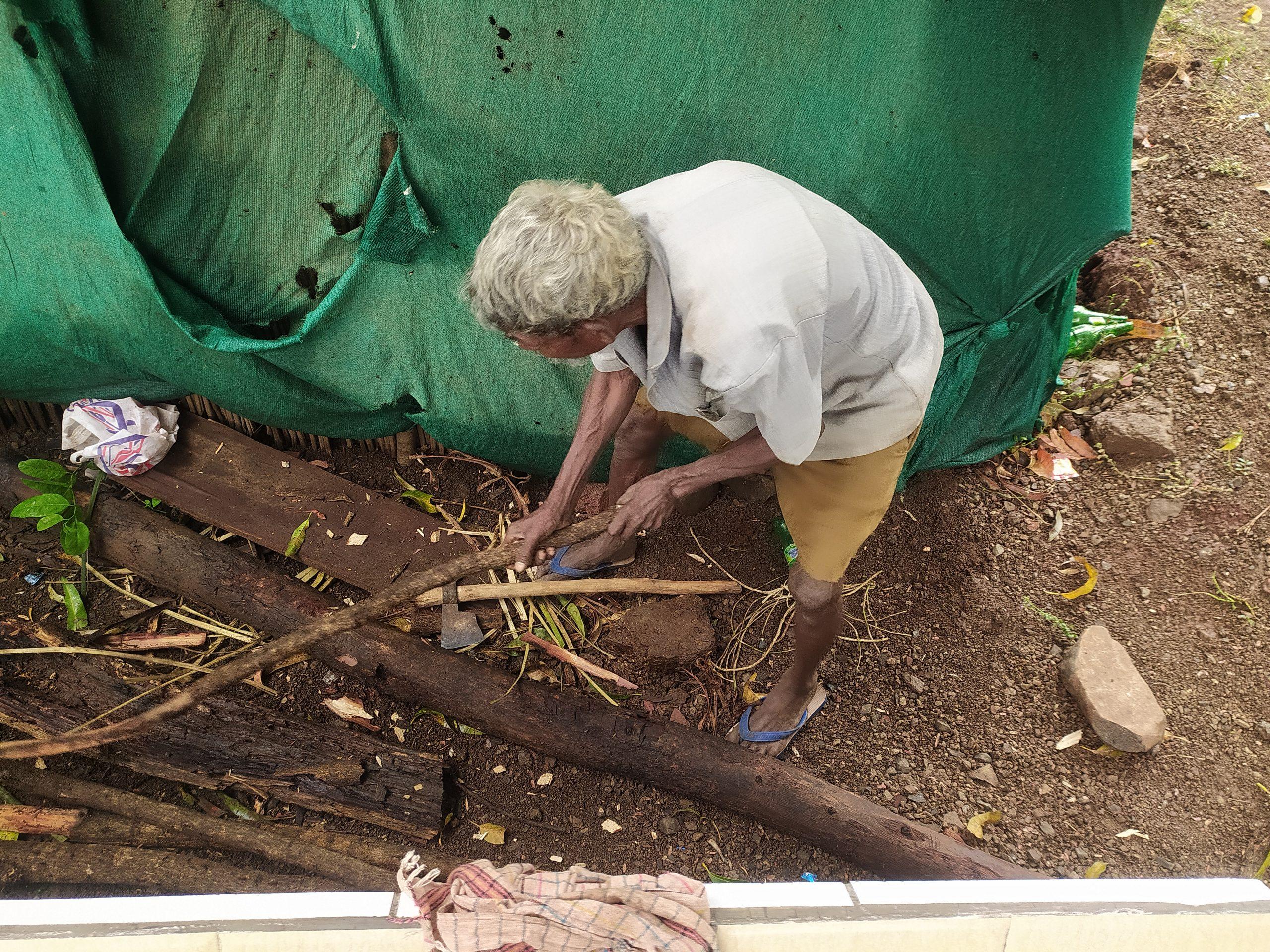 A man cutting woods