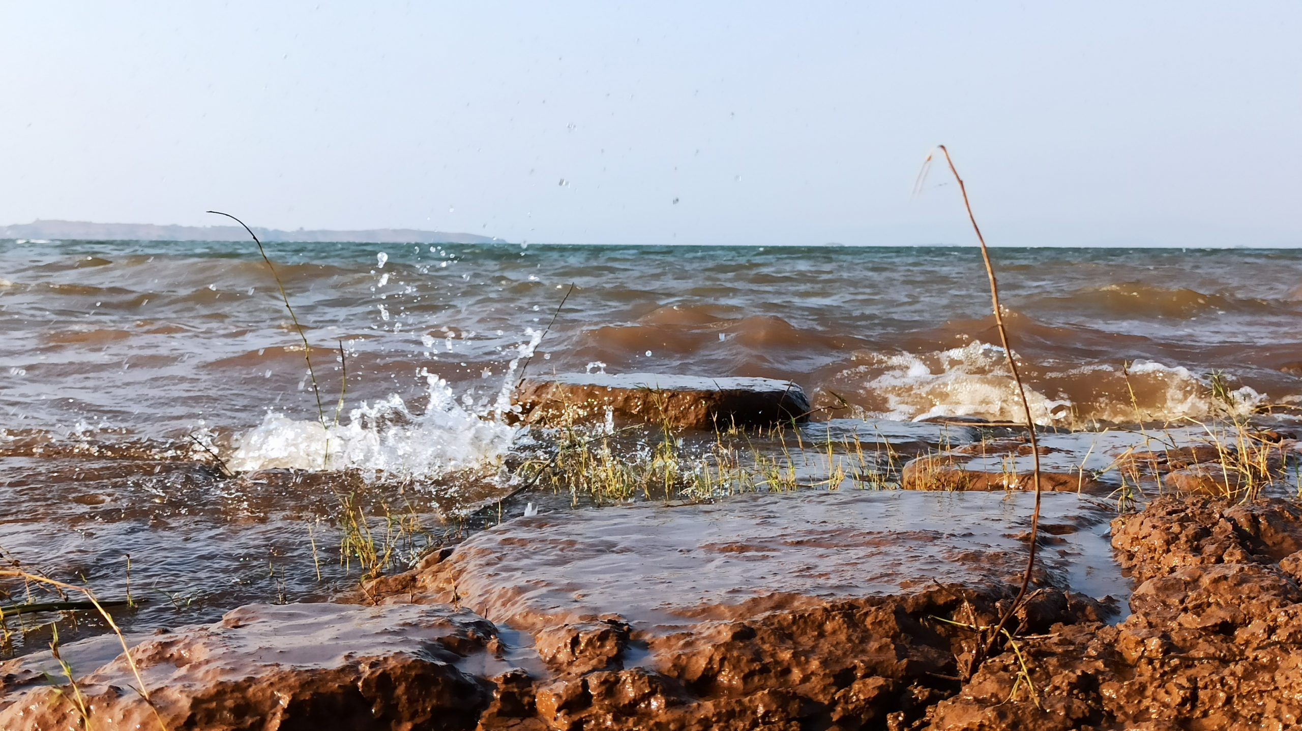 waves splashing against rocks