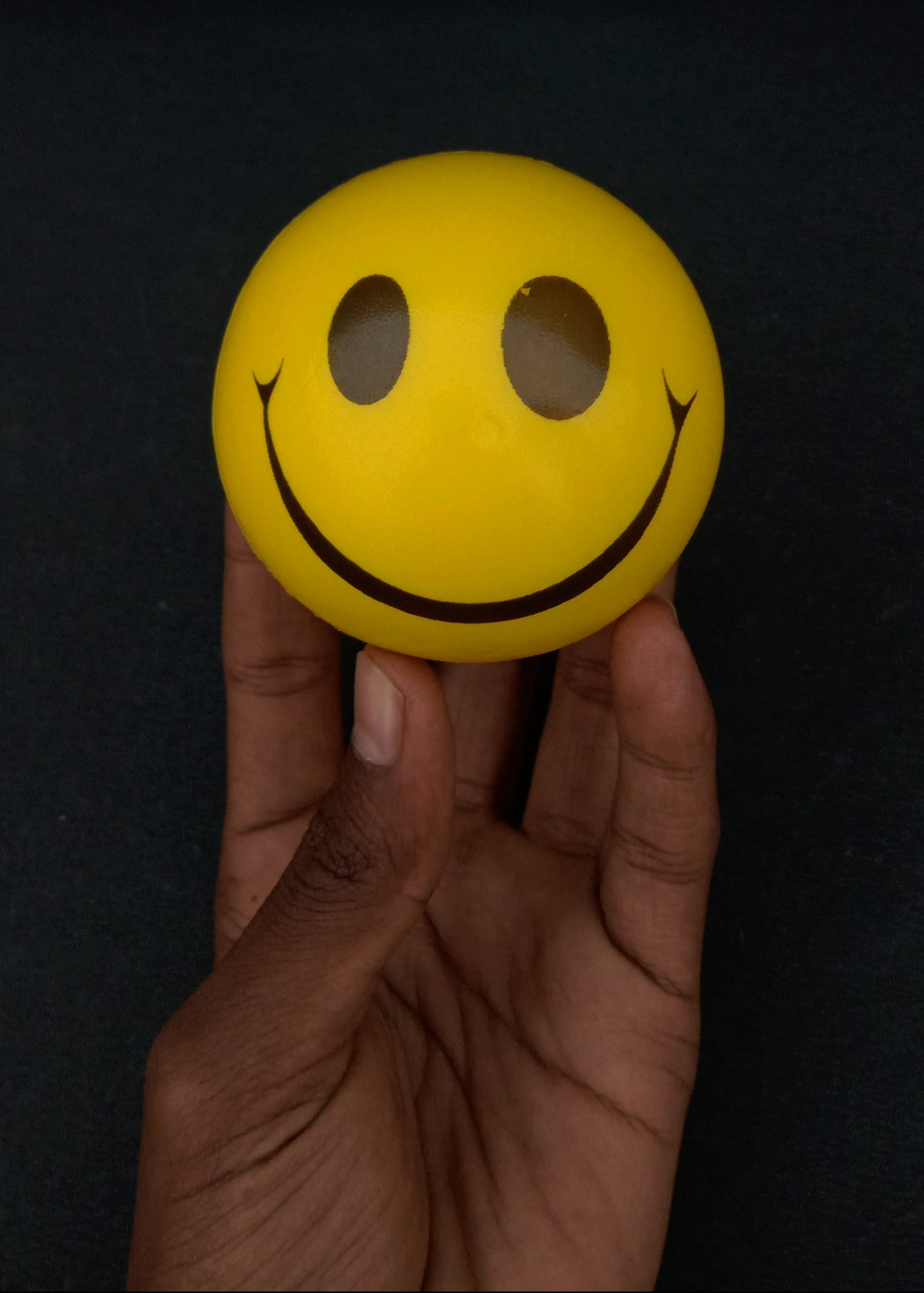 smiley ball in hand