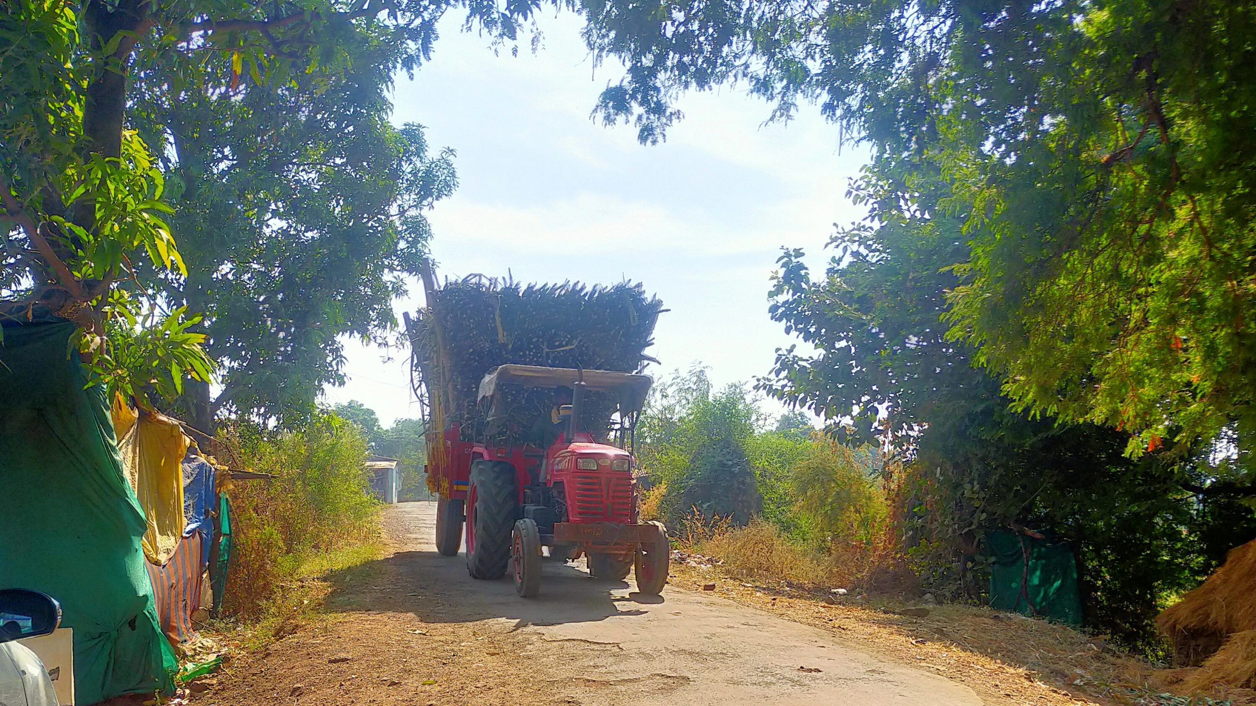 A tractor carrying load