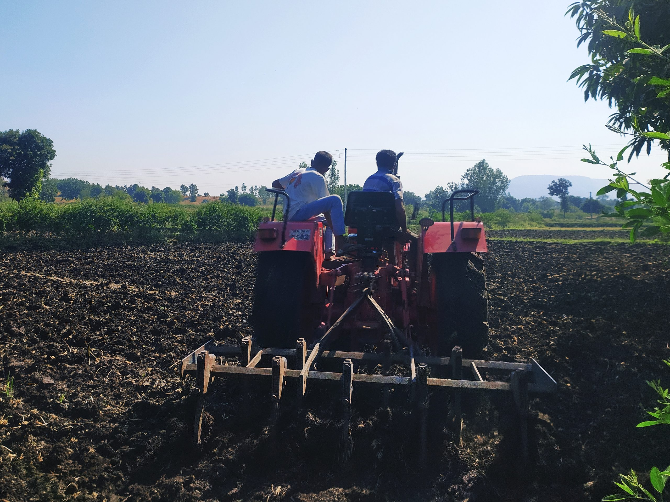 A tractor cultivating a field